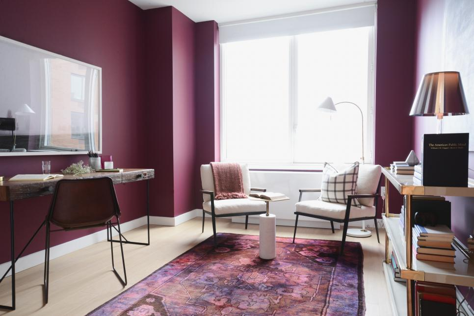 Berry walls infuse this office with creative vibes. Via  HGTV .