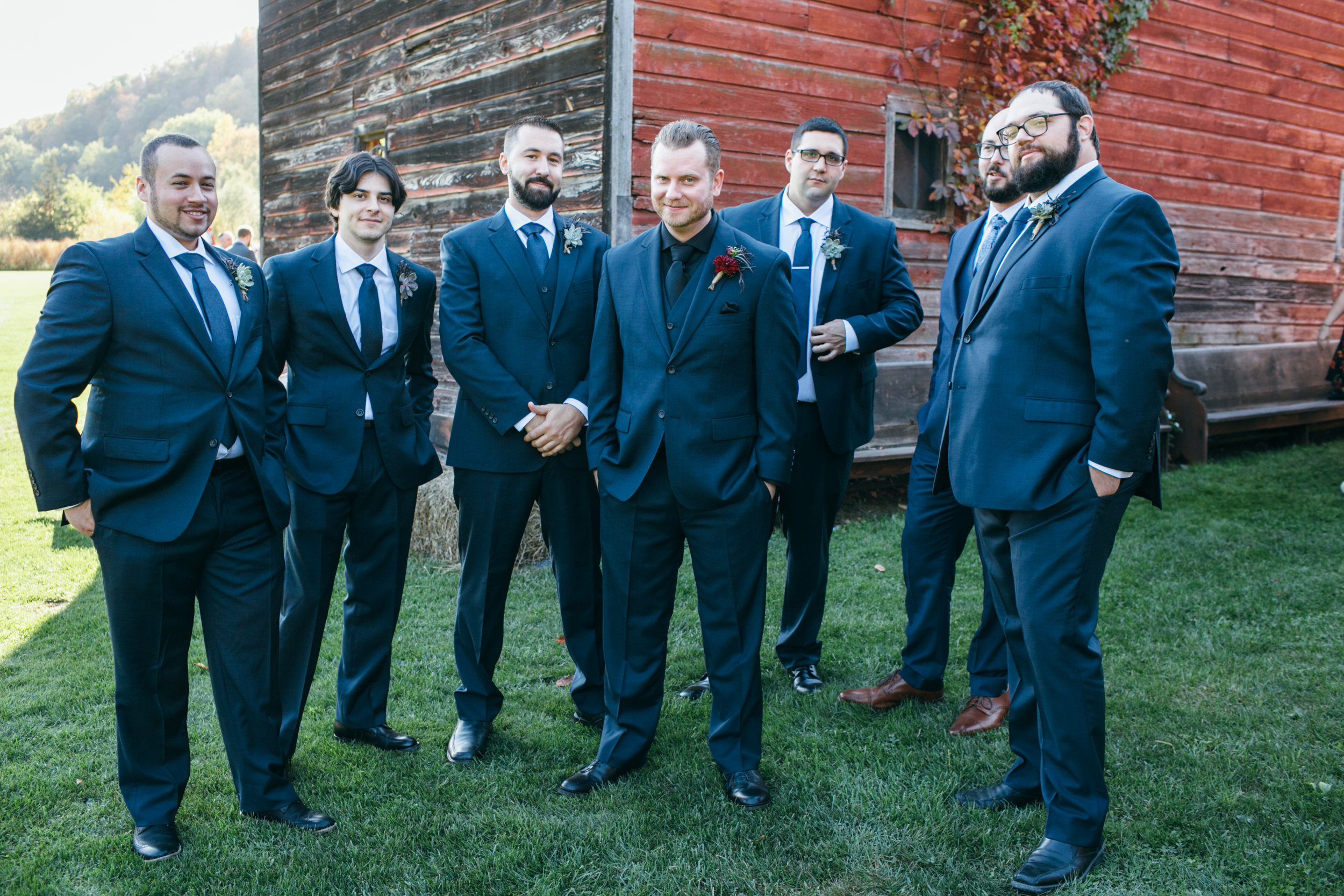 Succulents were also used in the bridesmaid's bouquets and the gentlemen's boutonnieres, distinguishing these personal flowers from the special couple, while pulling in another one their favorite floral elements.