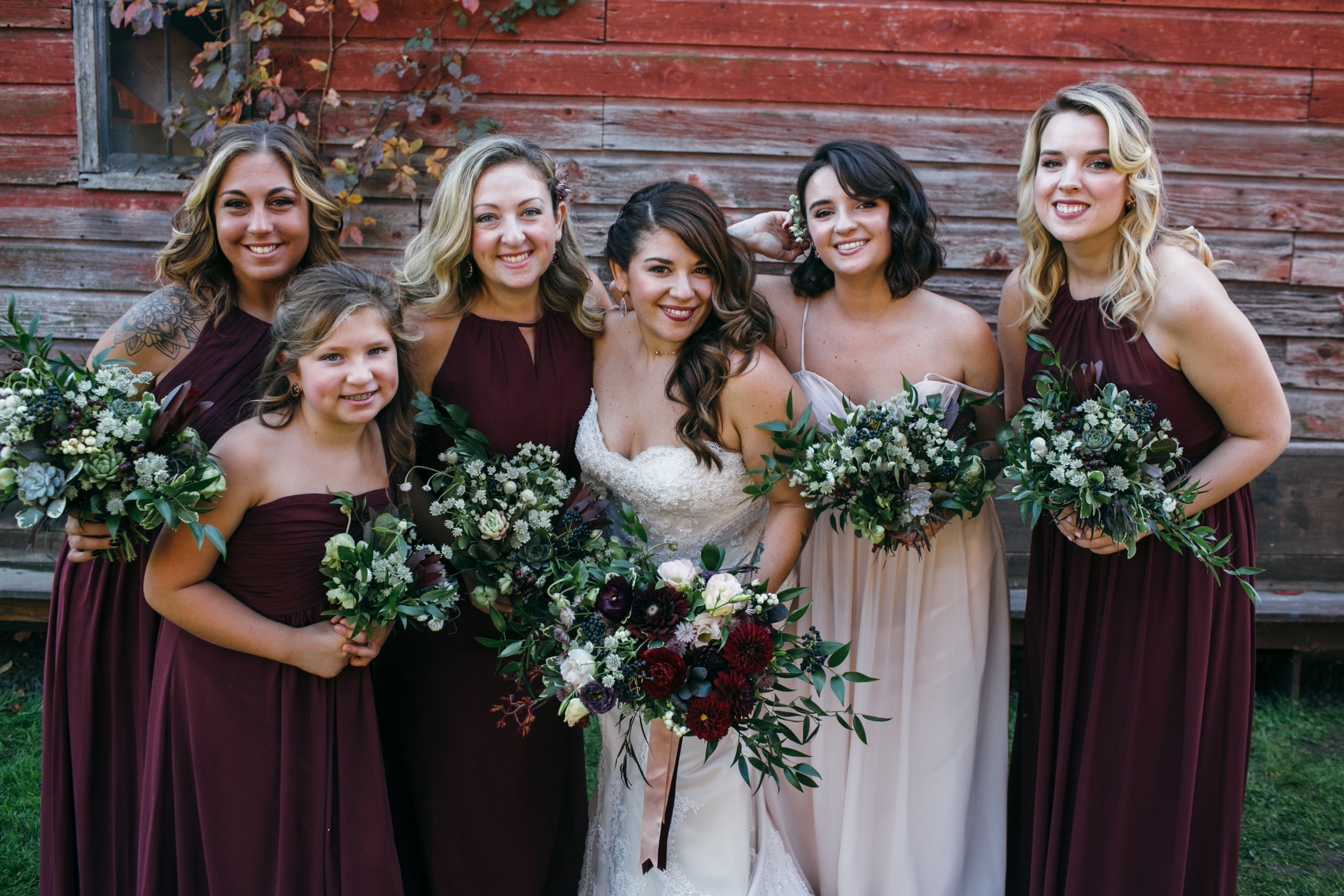 Coordinating the rest of the bridal party with the bride and groom doesn't always mean using the same flowers or colors. For this event, complimentary colors, reflective elements, and contrasting textures were carefully selected to keep the entire group in sync.    The bride's bouquet used ribbons that matched the color and texture of the dresses worn by her maid-of-honor and other bridesmaids, while their bouquets feature white flowers that reflected the bride's gown.