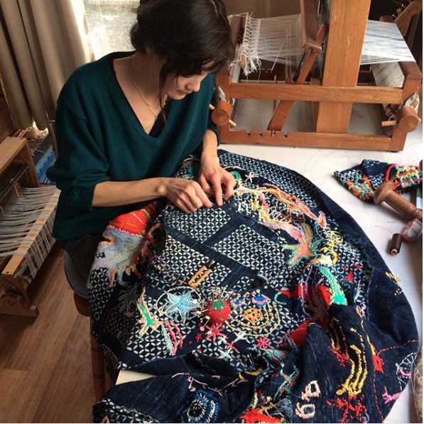 Rachel embriods on handwoven African mud-printed cotton. A piece that was started in 2014.