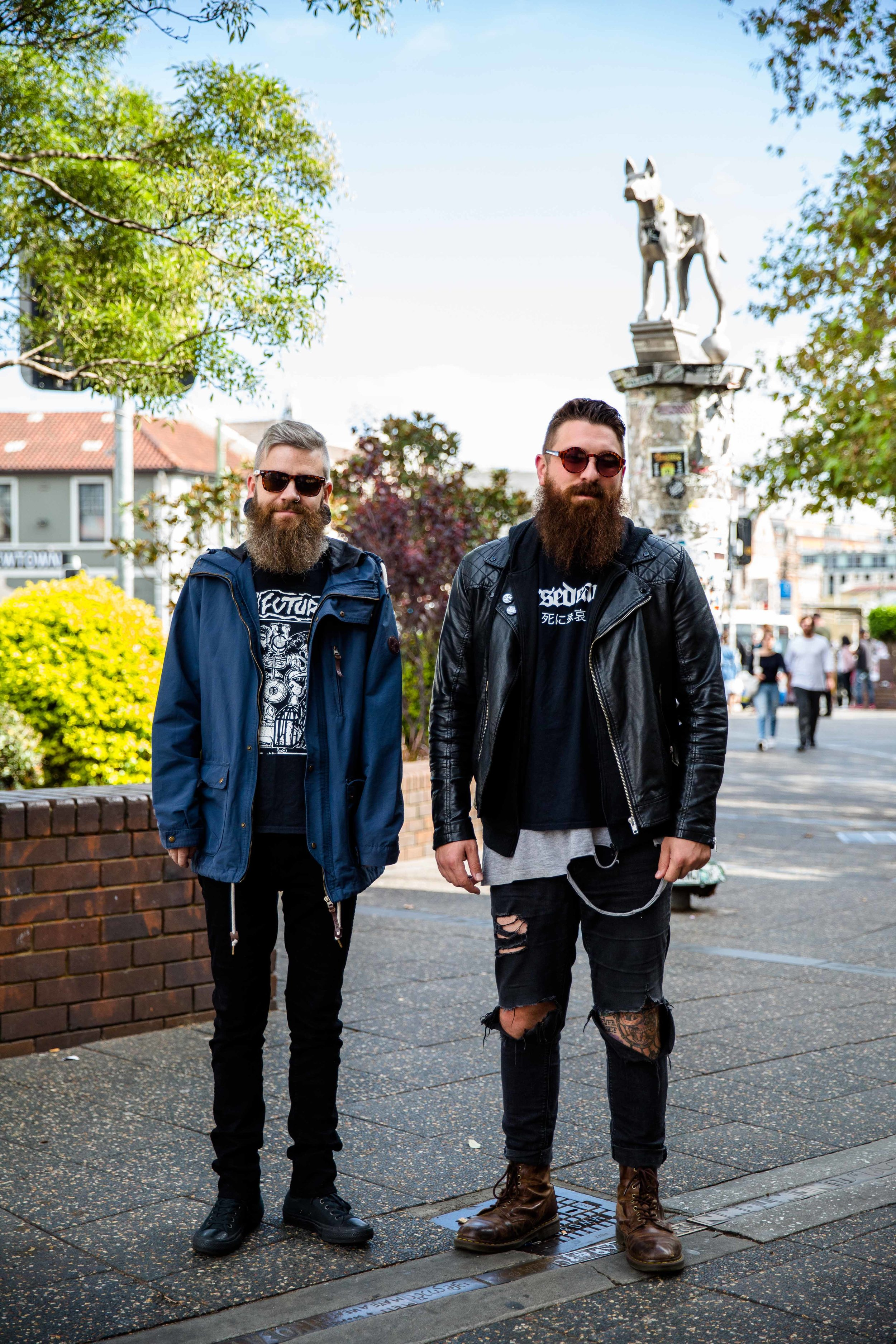 Some gentlemen on the streets of Newtown wearing vintage and second finds. The gentlemen on the right shared with us that he up-cycled hus jumper by cutting out the hoodie and  created natural looking wear and tear in his shirt for a more edgy, street look.