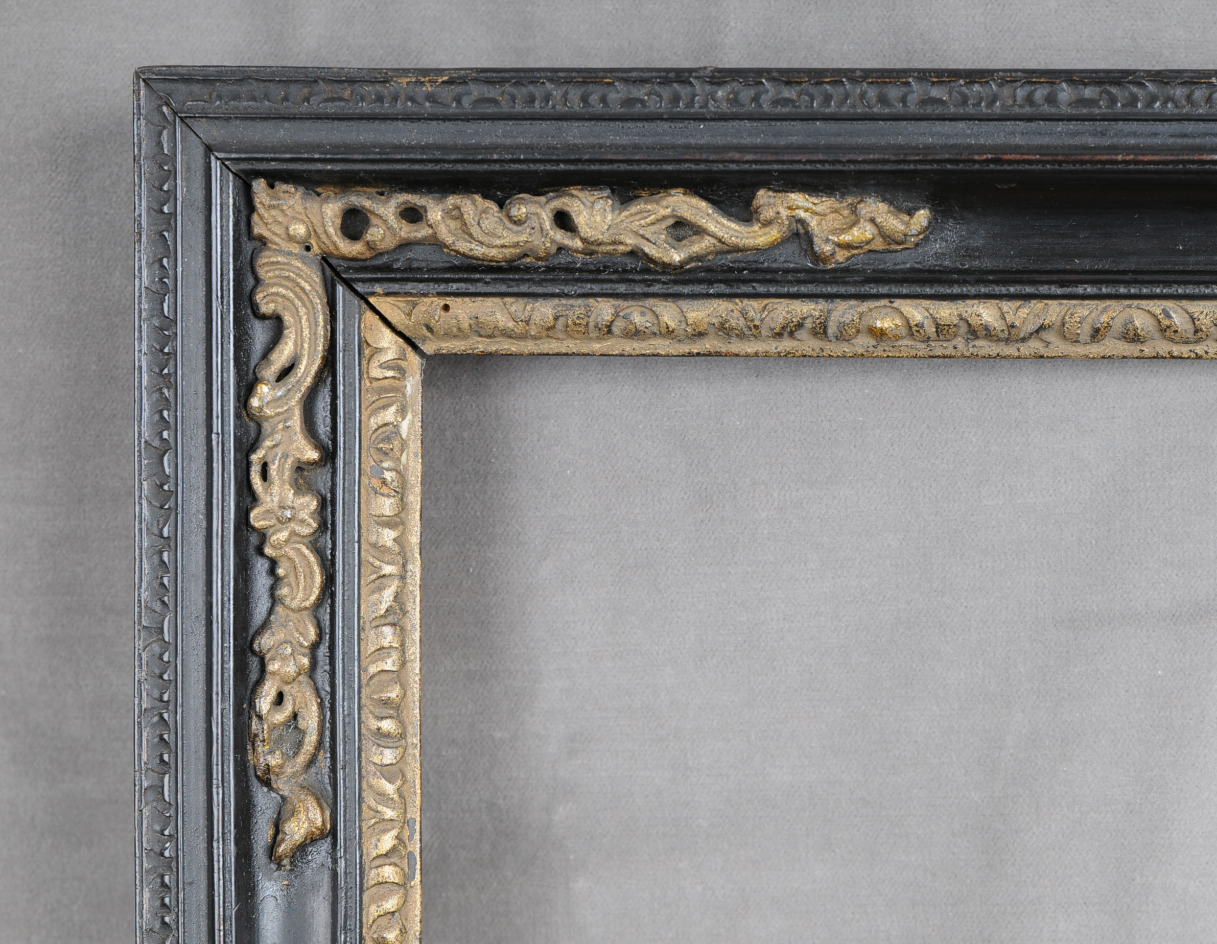 Eighteenth century Peartree frame with gilded lead corner ornament