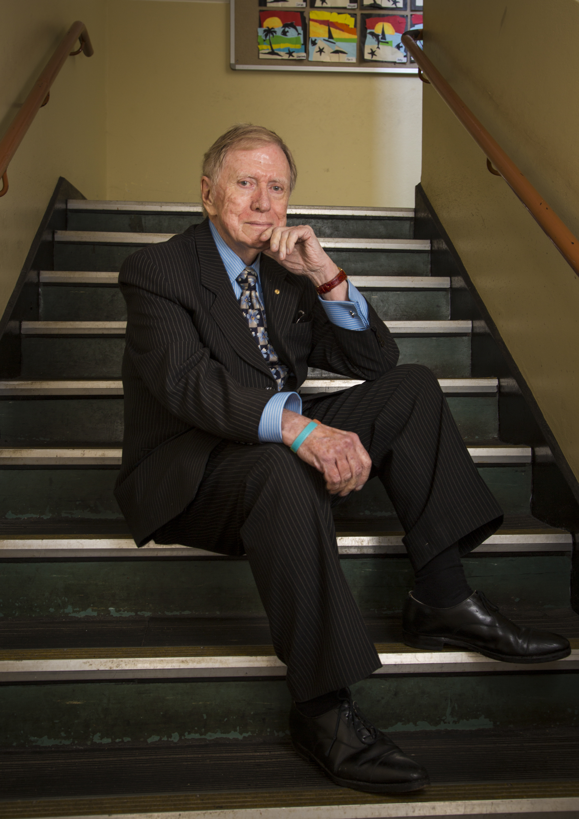 Michael Kirby, pictured on the steps of the old infants' building at his first school, now Strathfield North Public School.
