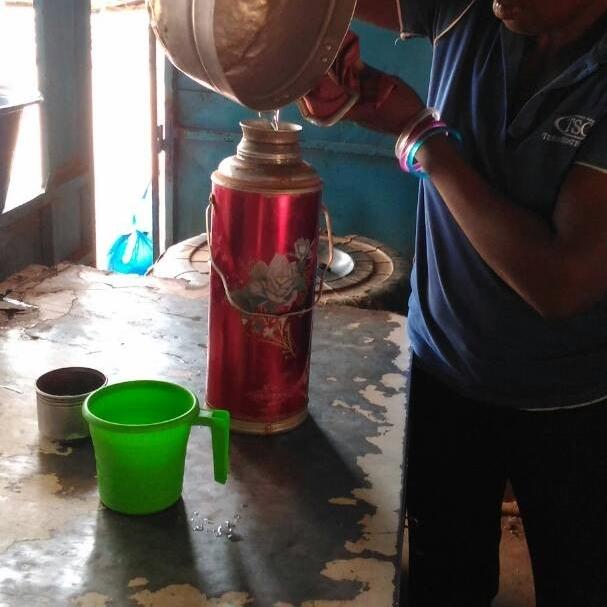 Maddo serving water.jpg