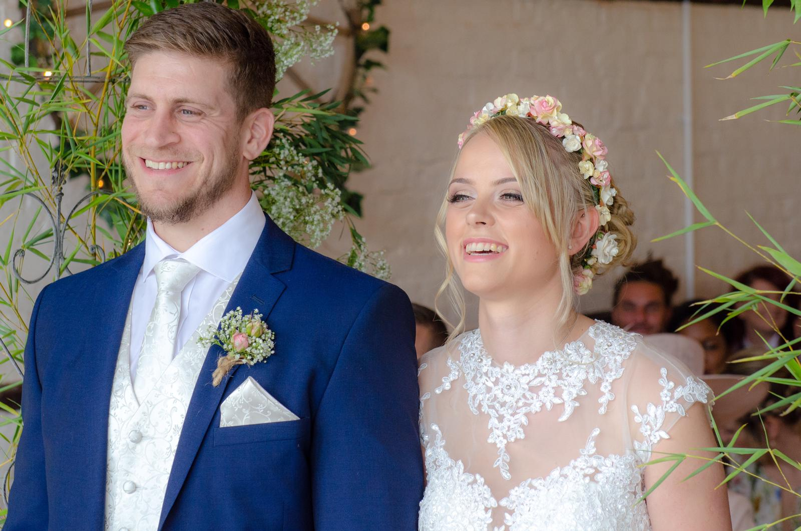 Beautiful bride and groom during nuptials