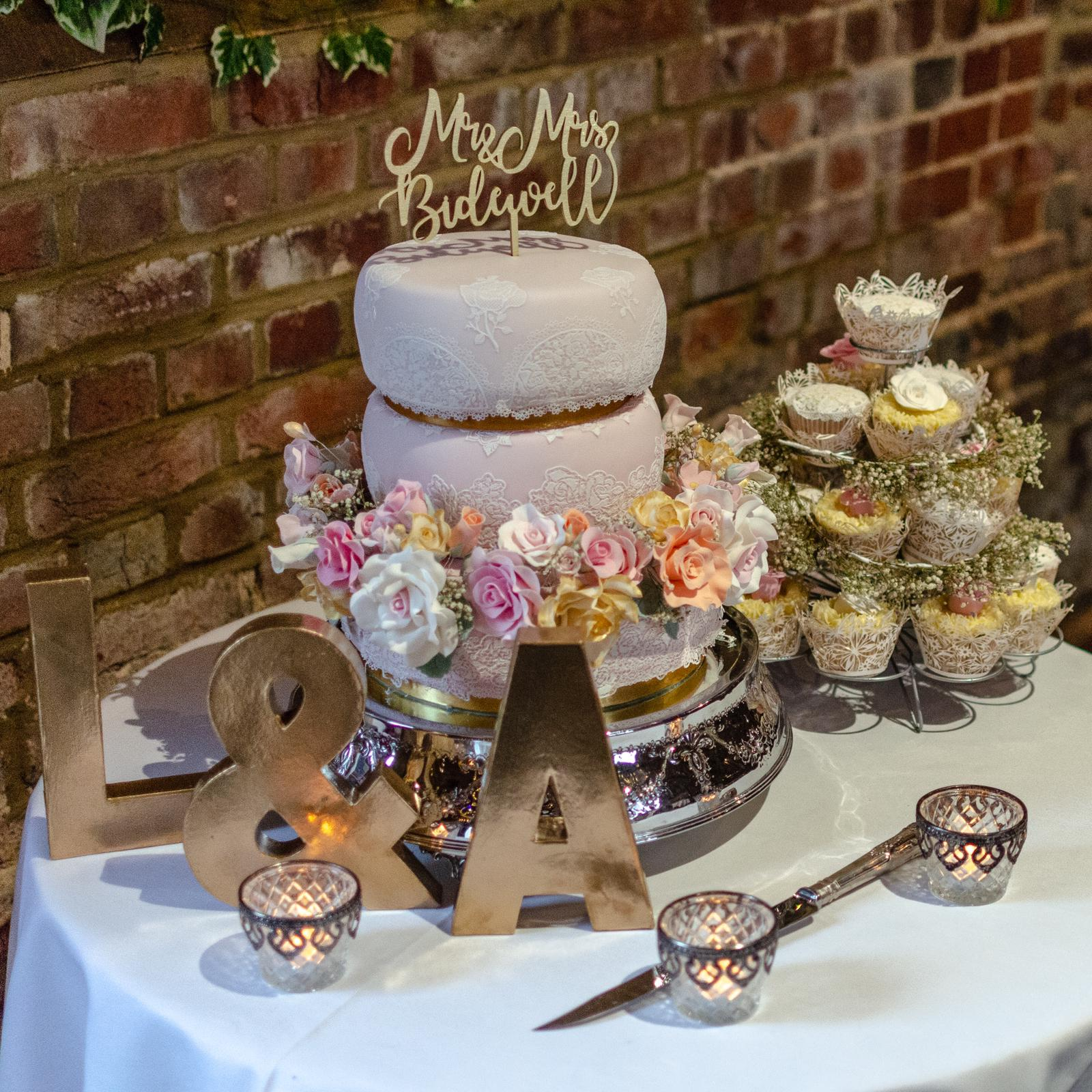 Rustic inspired wedding cake and decorations on table