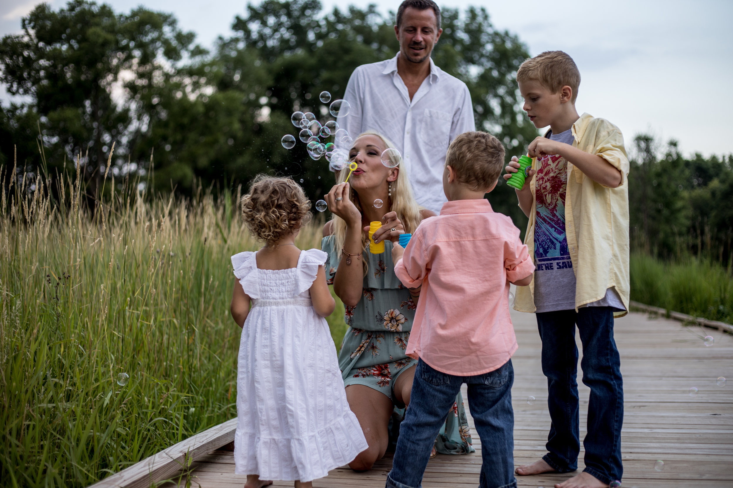 Blowing Bubbles: Green Isle Park Golden Hour Family Session