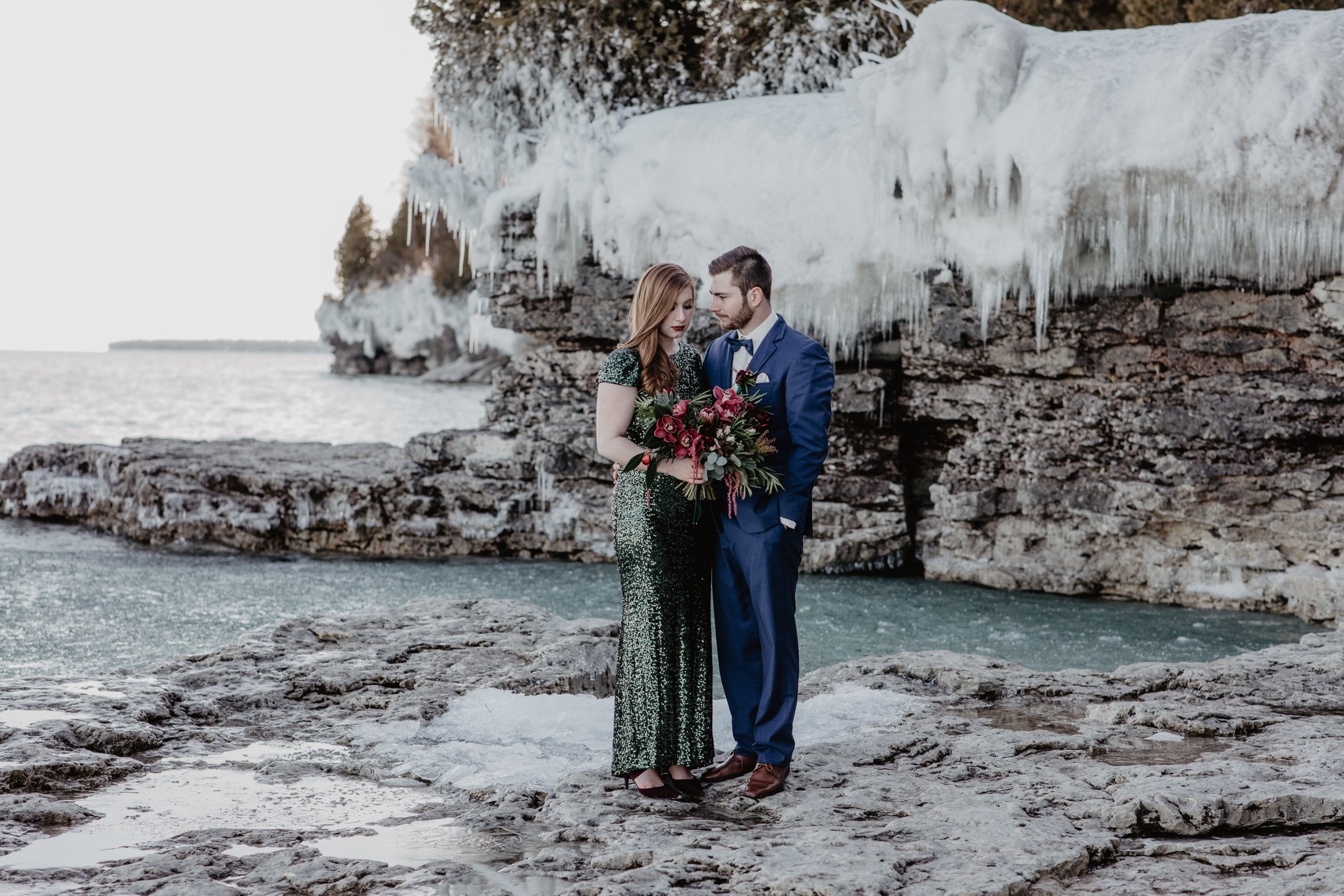 A Romantic Jewel Tone Inspired Shoot - Green Sequin Dress - Navy Suits by Zegers Clotheirs, Florals by Ebb & Flow, Makeup & Hair by Jillian Dawson, Cave Point - Winter Elopement