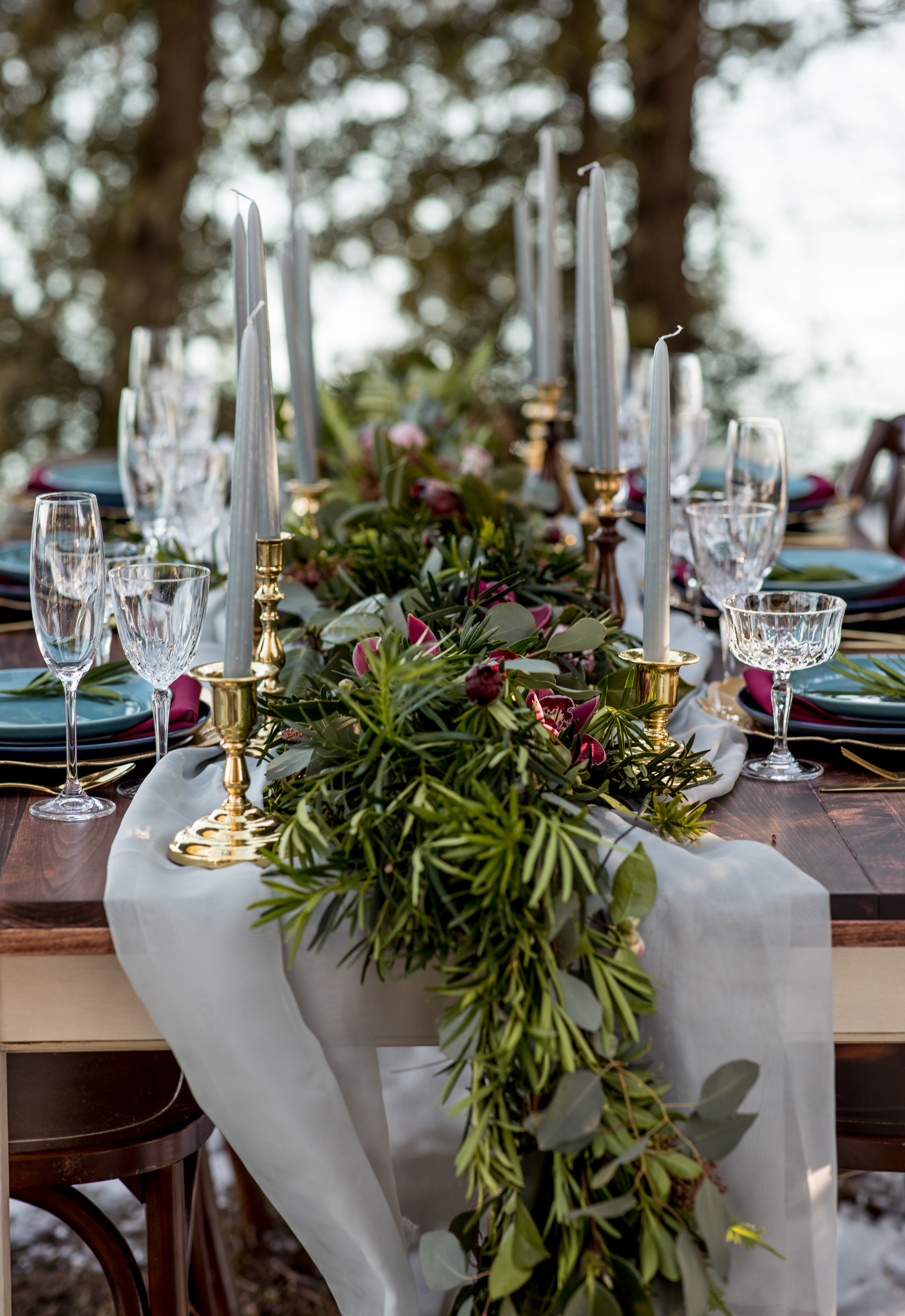 Vintage Farmhouse Tables - Ebb & Flow Florals - Cave Point - Cascading Greenery with Pops of Wine Colored Orchids - With Hints of Gold Accents - Jewel Tones Complimenting the Deep Stained Wooden Tables - Hove Photography - International Wedding & Elopement Photographer.