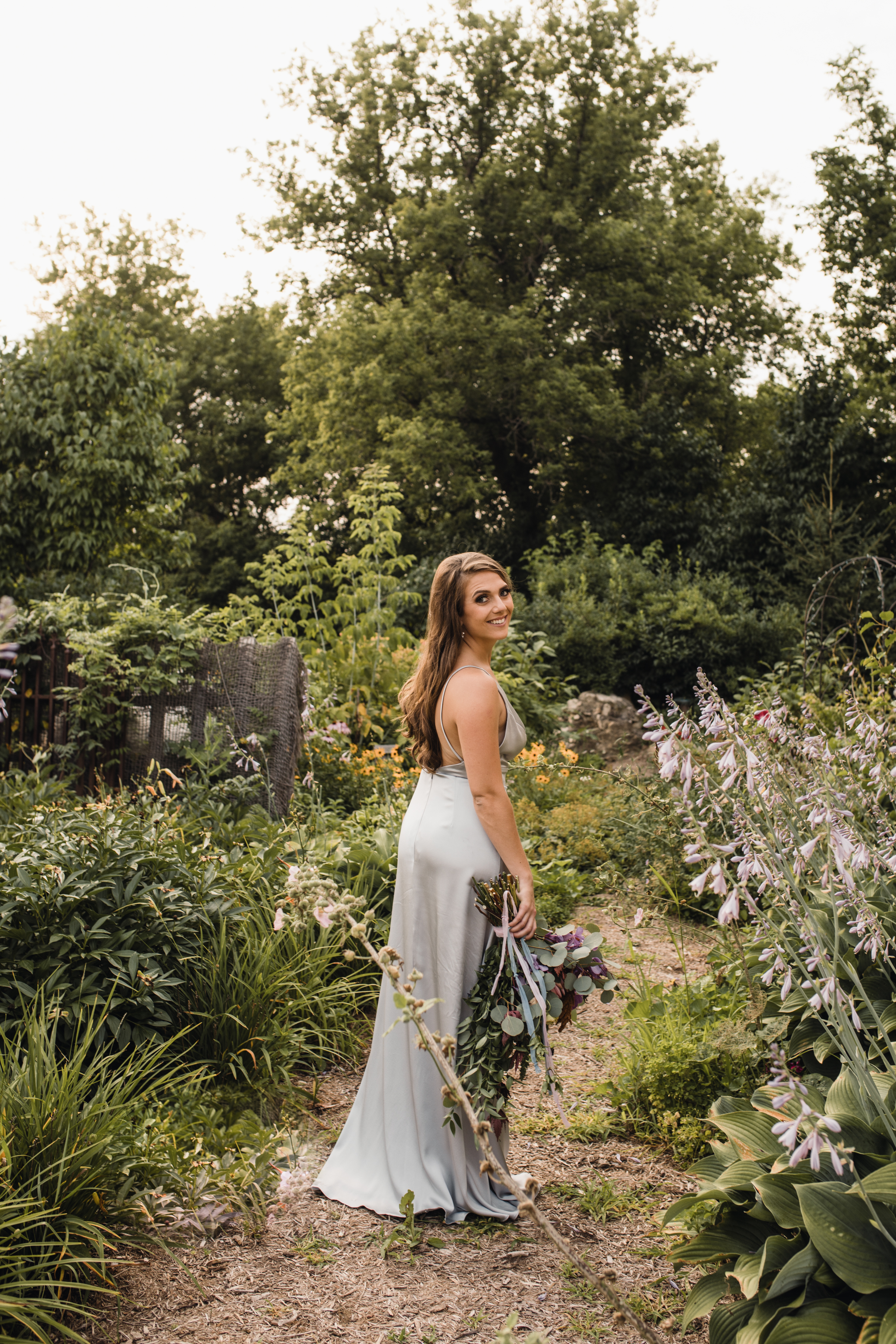 Stunning Simple, Delicate and Romantic Vene AI custom gown accompanied by Jennifer Joyce dynamic floral bouquet. Ashley showing off the amazing low back of this gown!