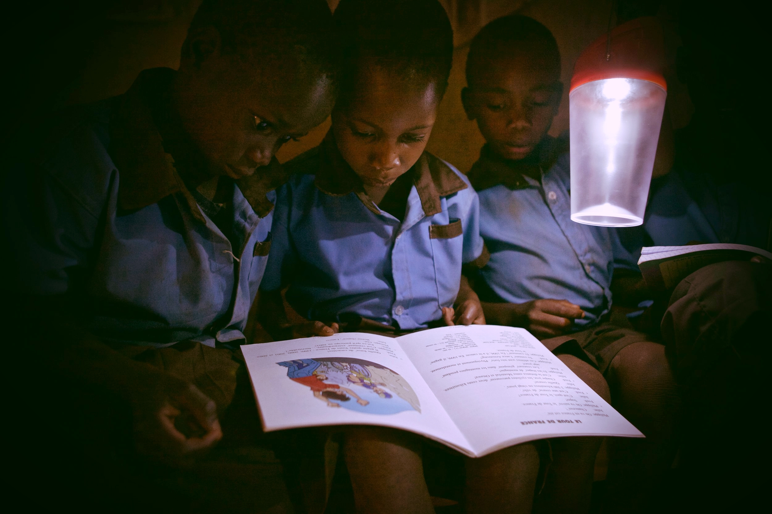 The solar lamps seen in this photo are the same lamps we'll be purchasing for every student.