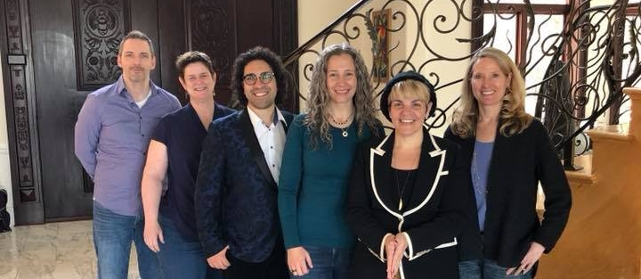 Majeed Mogharreban (blue jacket + glasses) next to me with other coaches and mentors of mine! From left to Right : Robin Thompson (marketing expert), Pam Prior (my CFO), Majeed Mogharreban (expert speaker coach), Erika Flint (me), Angela Lauria (my publisher / mentor), and Karen Stultz (my COO).
