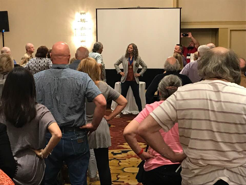 We're doing a power pose here during the Stress Busters workshop! -