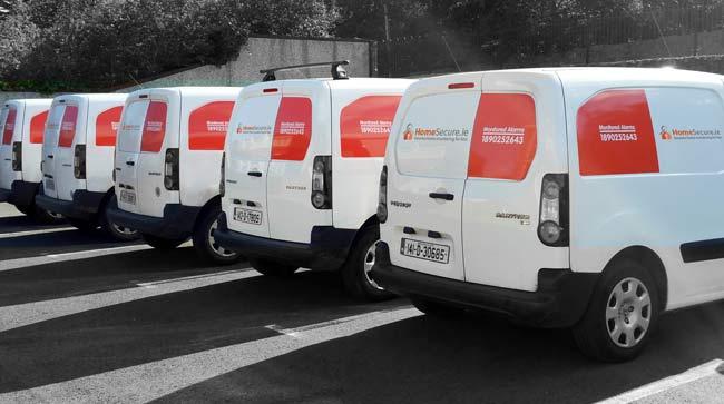 row of homesecure insaller vans