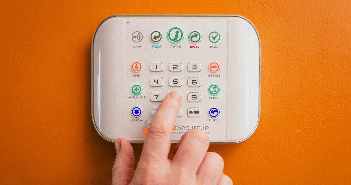 hand on burglar alarm panel