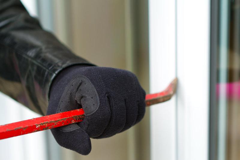 burglar crowbar in hand