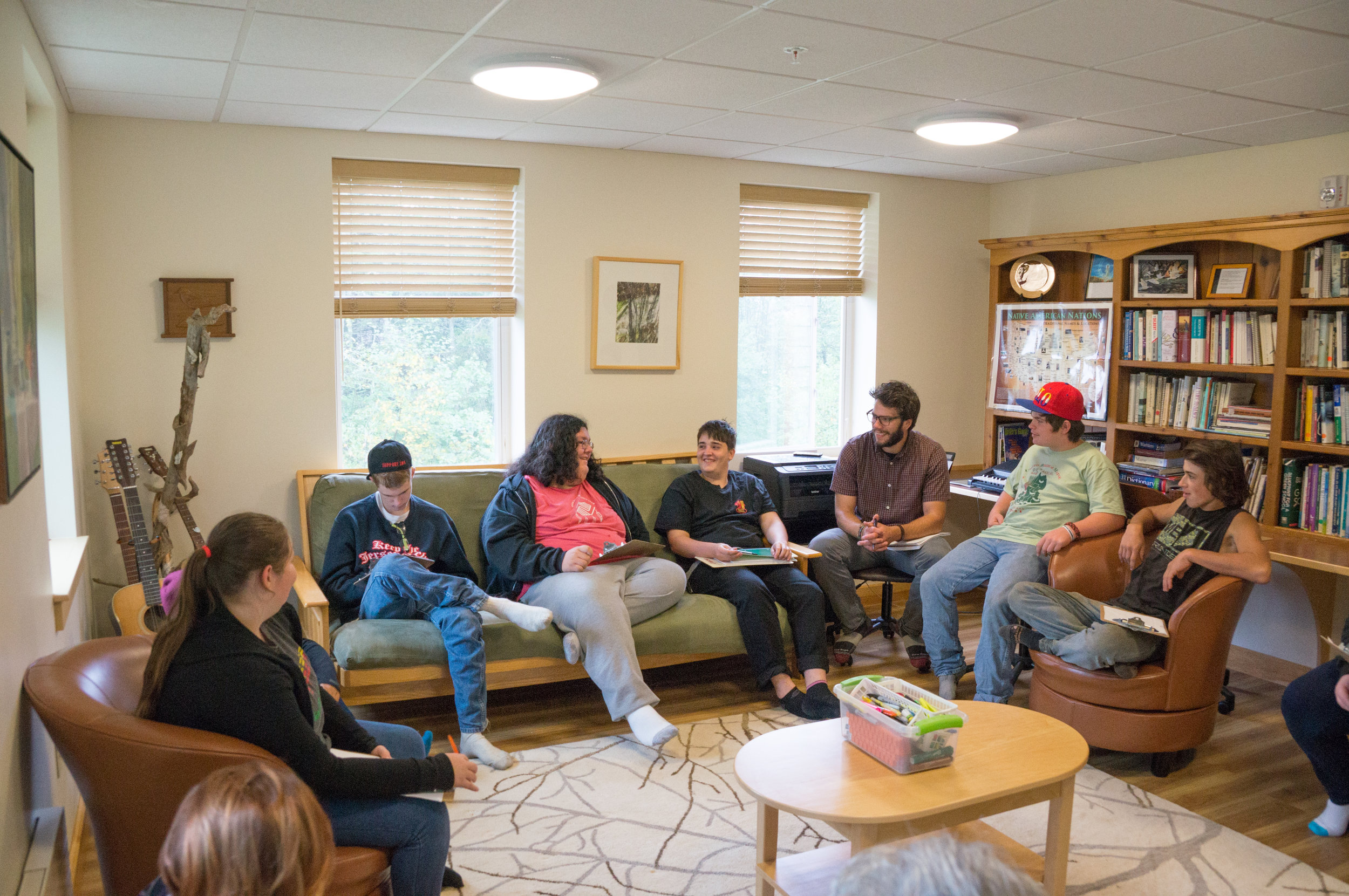 Students meeting with Marjorie Withers, former director of the Community Caring Collaborative