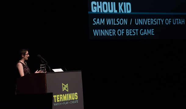 Last year's winner Sam Wilson accepting the award for best game