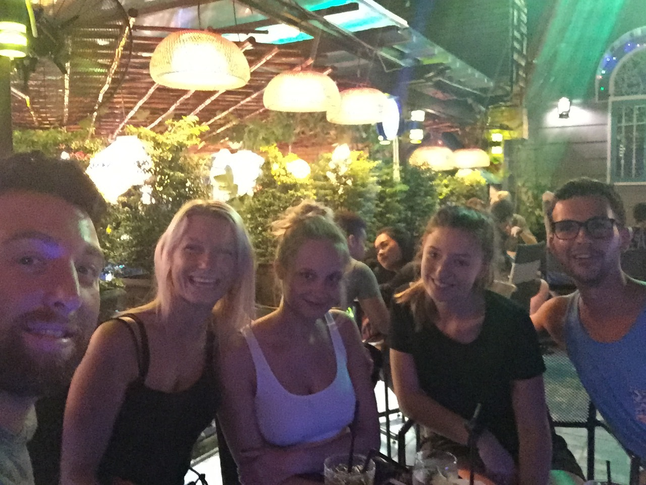 Refugees from Backpacker Street, grabbing a drink at a rooftop bar.