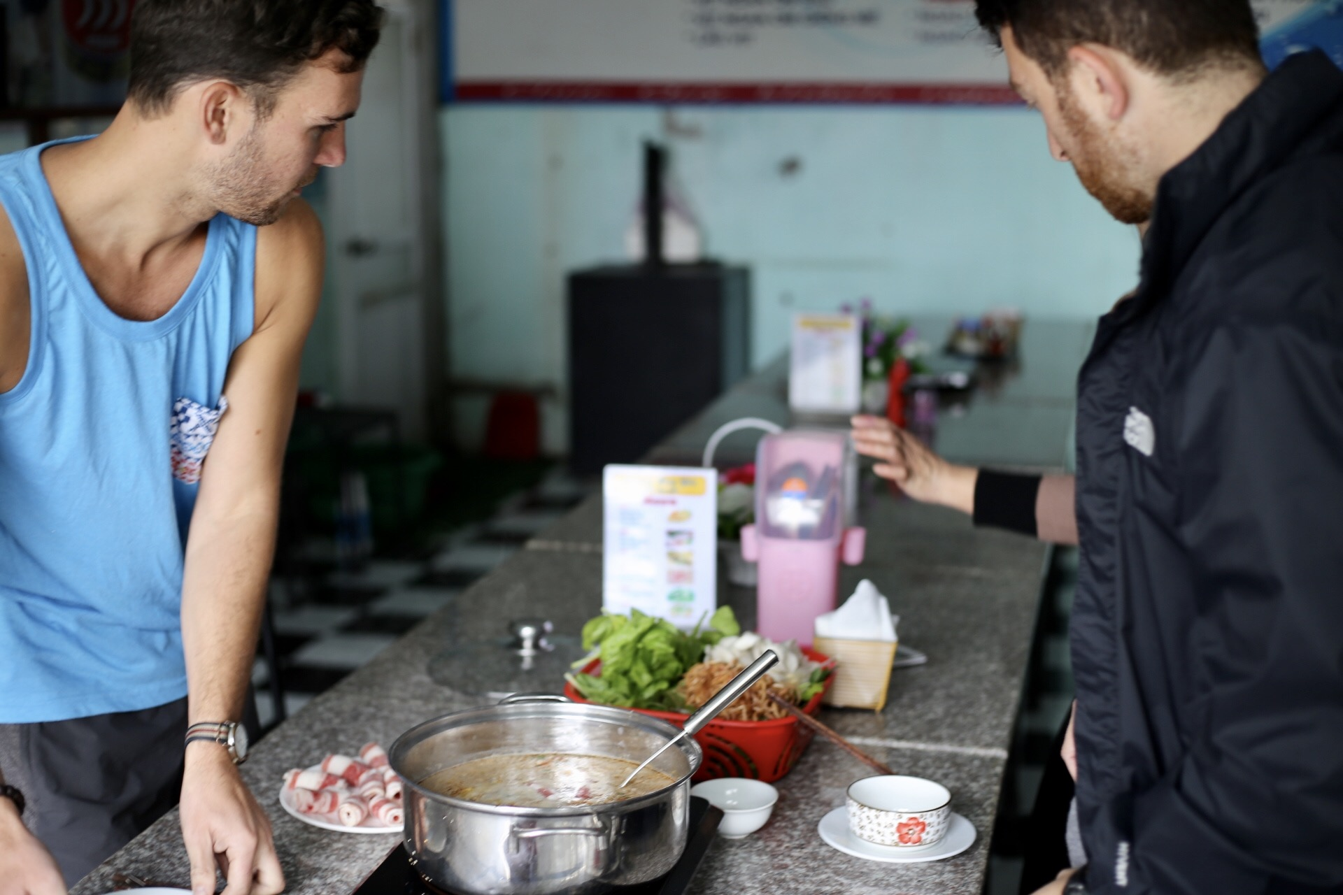 We had no common language with a hot pot restaurant on the way to Ninh Binh, so the owner had to teach us how to make our own lunch. (p/c: Sarah Hoffman)