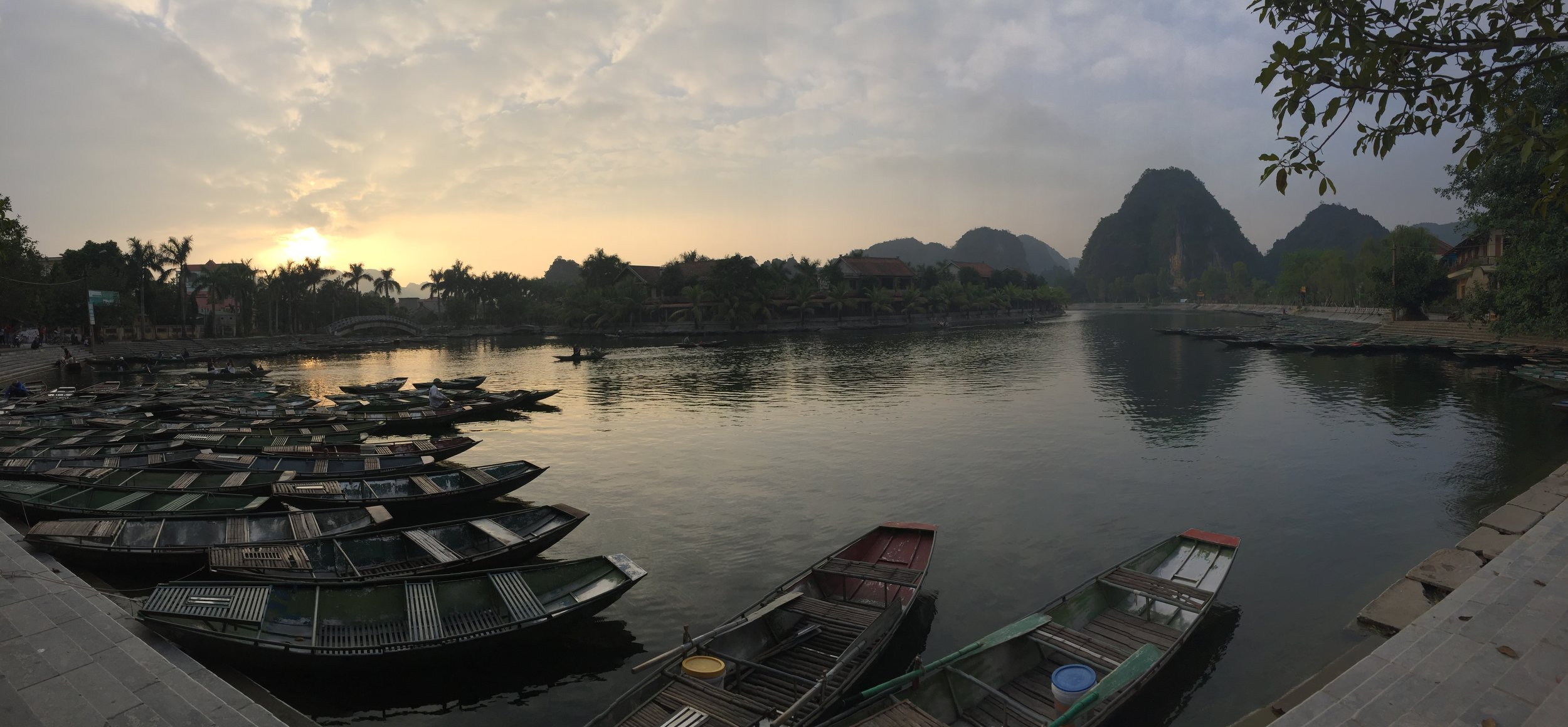 Sunset over Tam Coc lake by Ninh Binh.