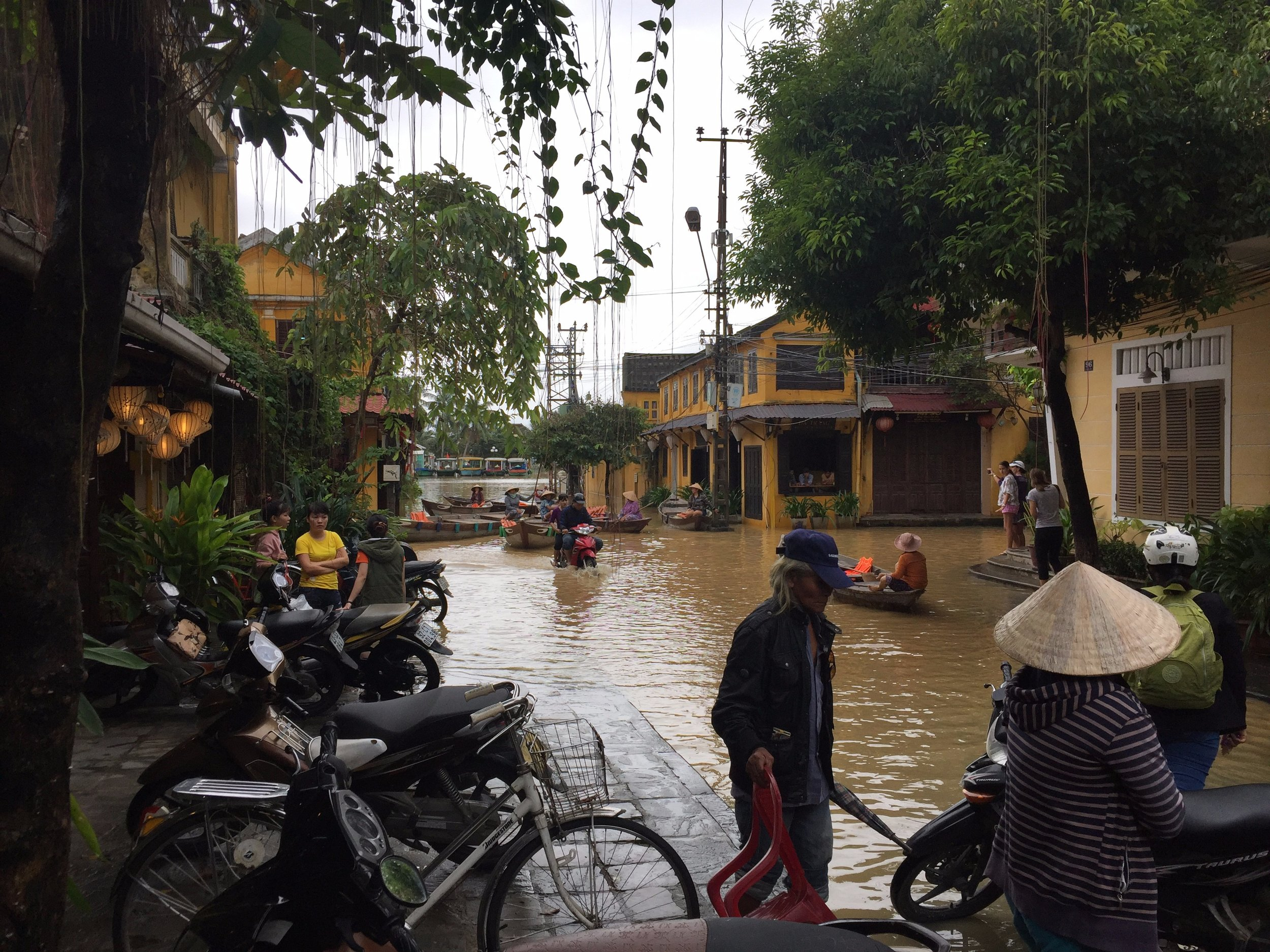 Leave it to enterprising locals to offer tourists boat rides down city streets immediately when it floods.