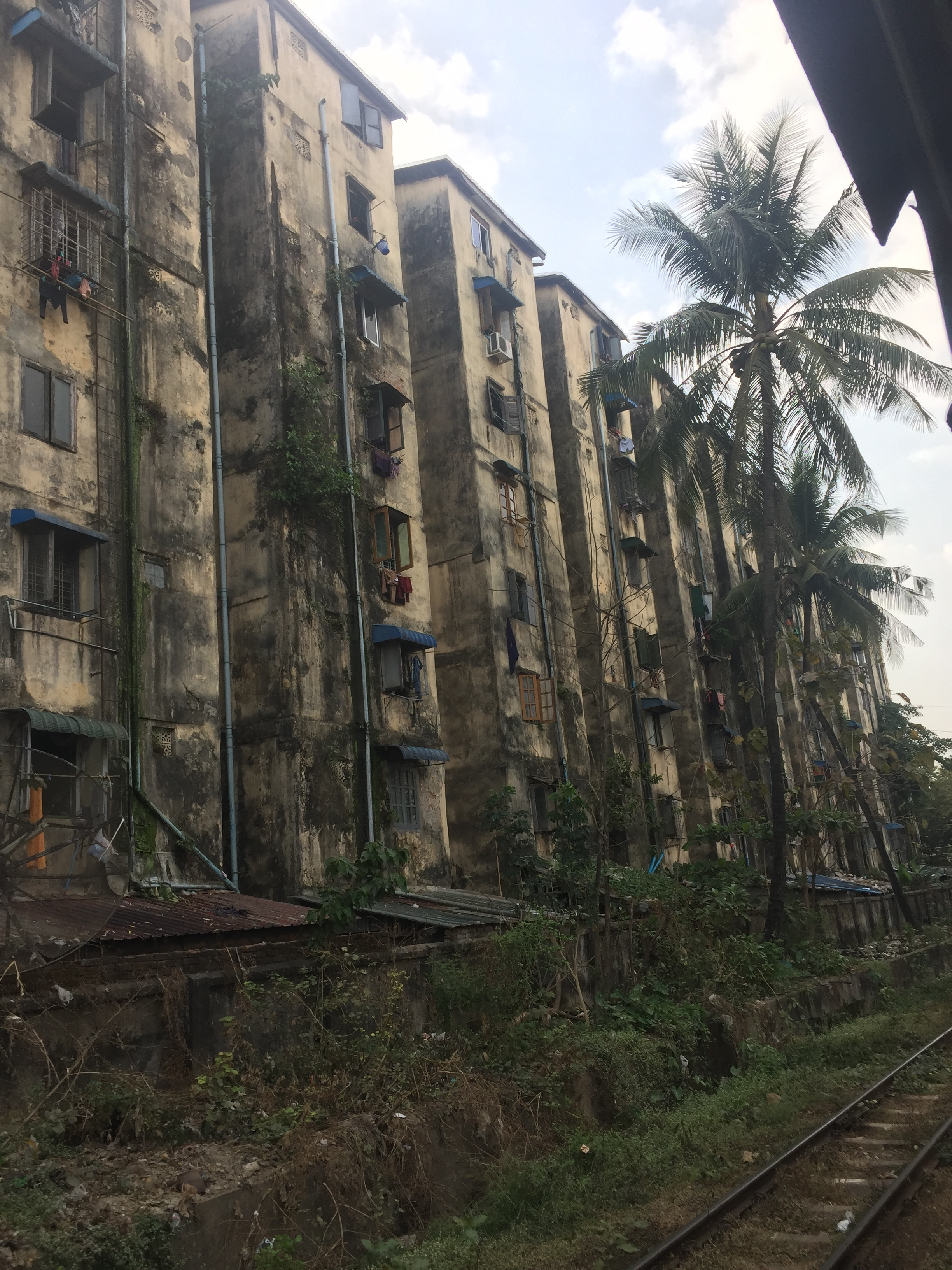 Slums, likely unkempt for years, along the railway tracks.