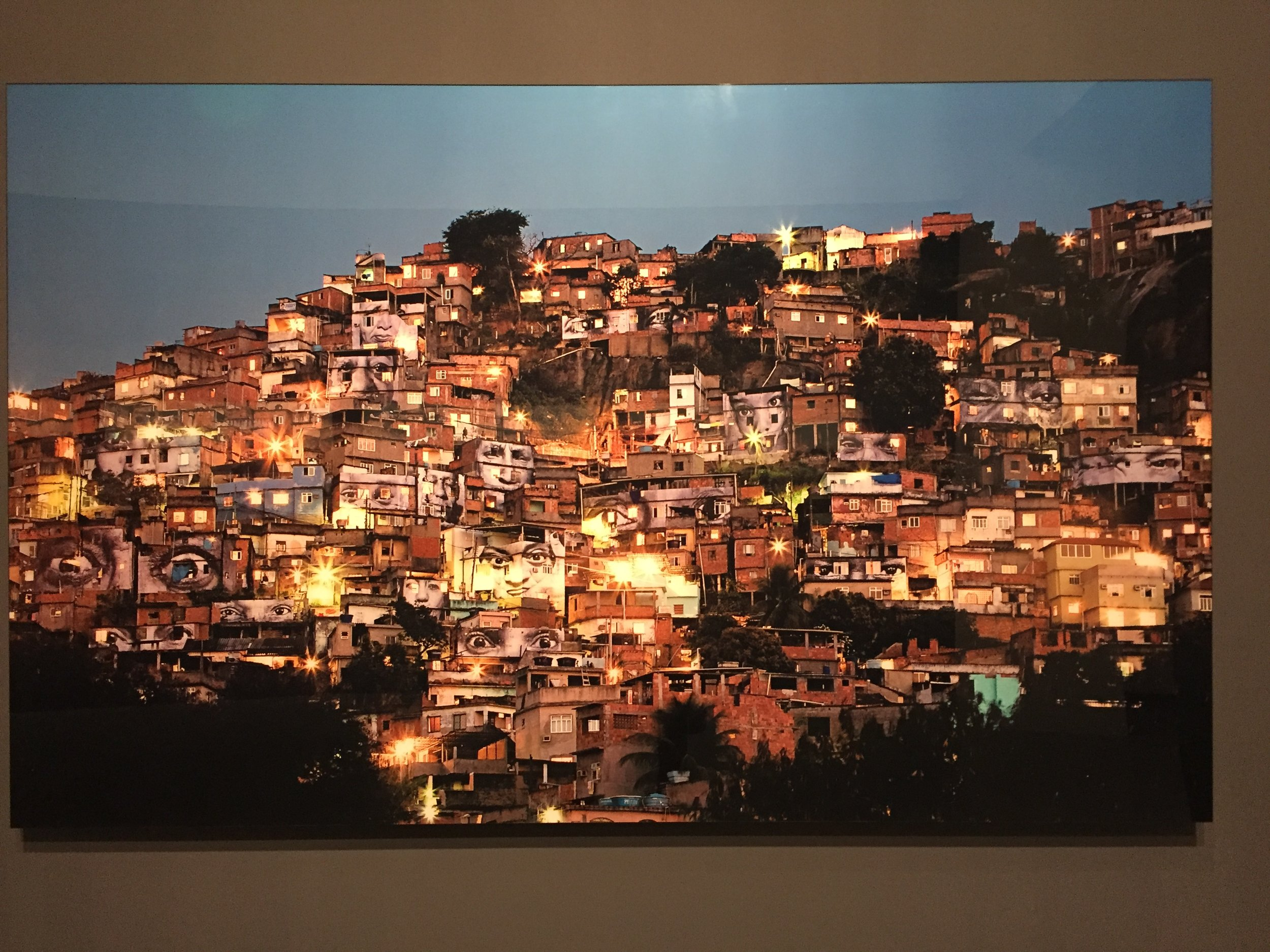 """The favelas of Rio, painted with faces by French street artist JR -part of an exhibition of his urban """"no frames""""art."""
