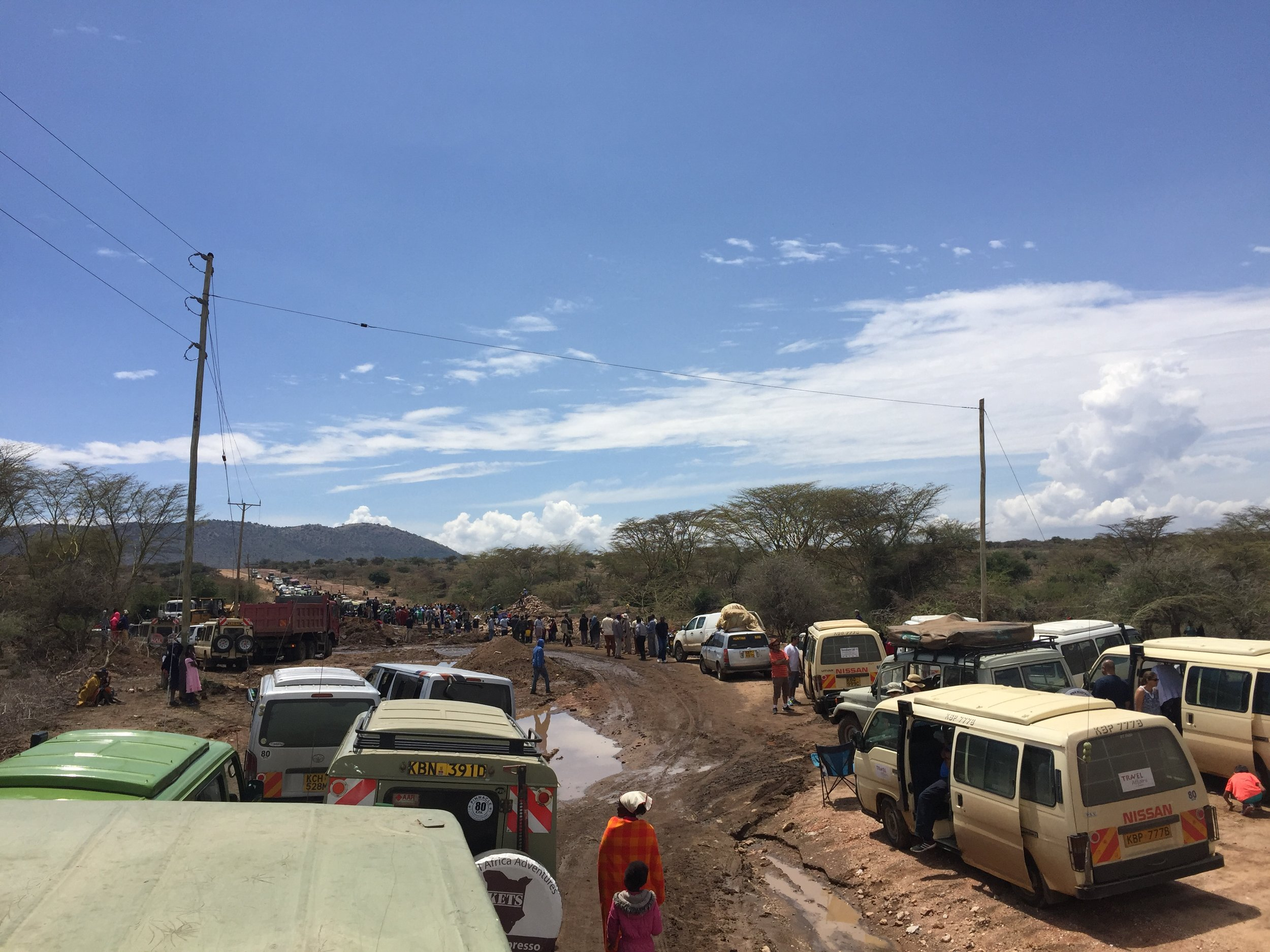 On our way into the Maasai Mara, the only road in washed out the night prior.