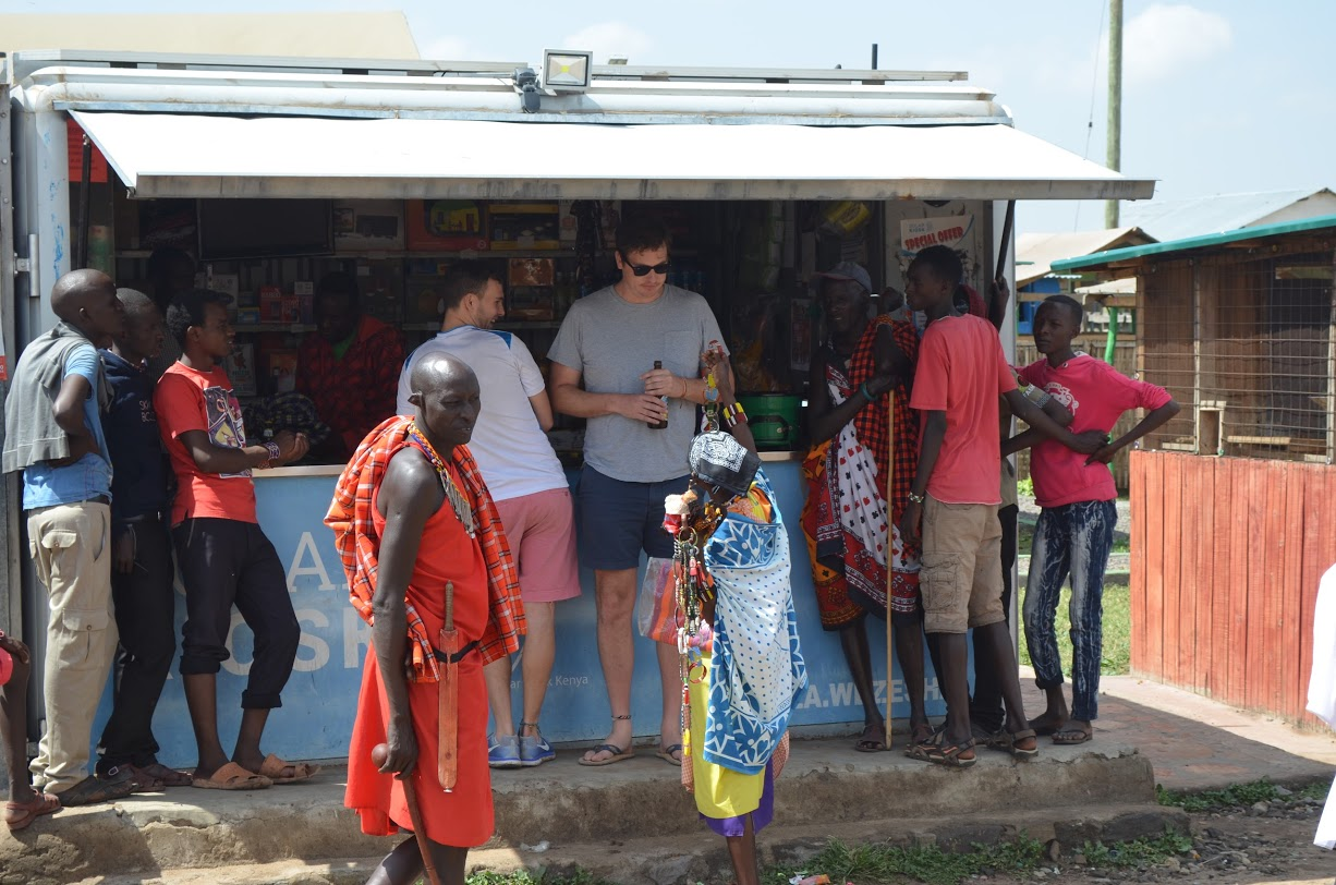 Scotty and I avoid Maasai trinket-sellers while picking up some beers.