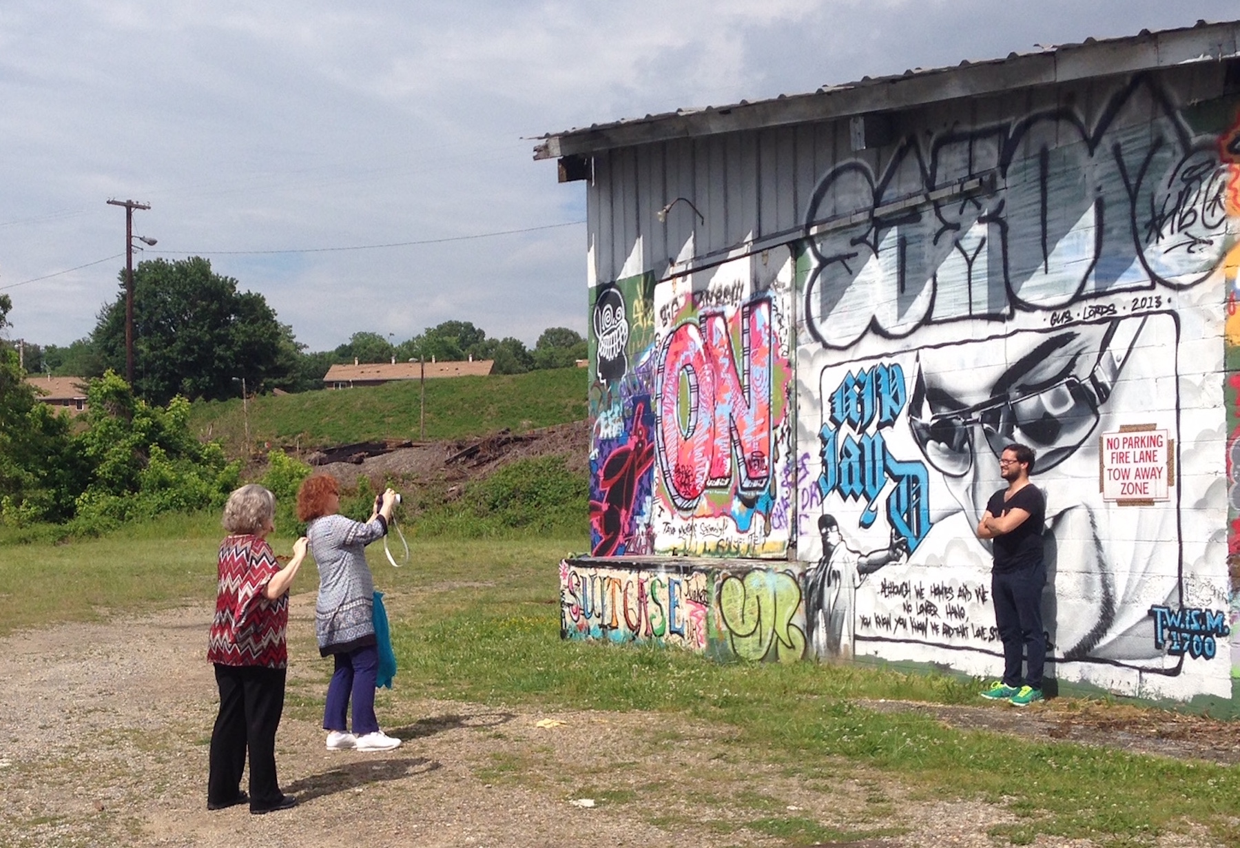 Journalists from France were fascinated by the murals in the River Arts District!