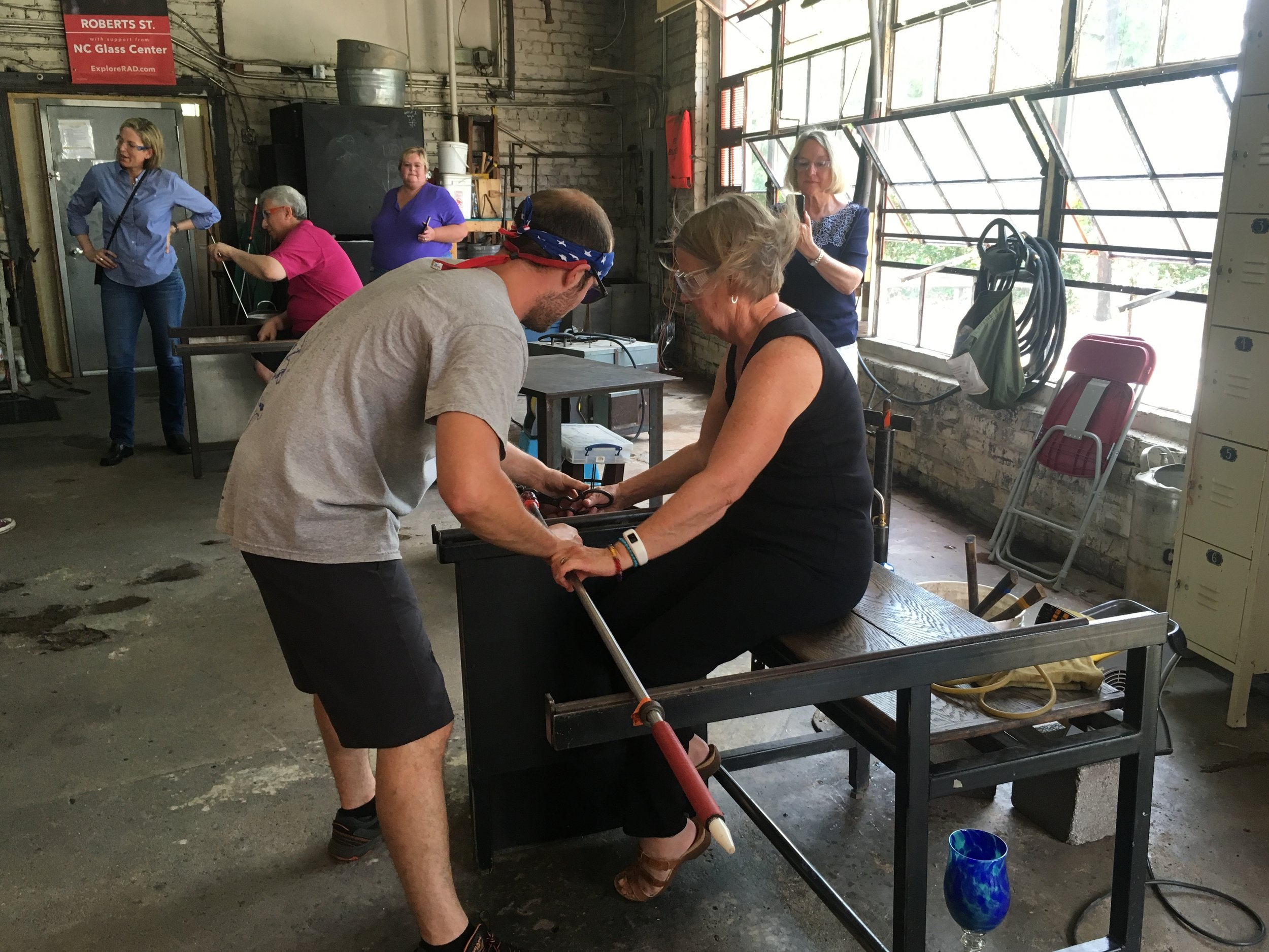 Getting a glass blowing lesson at the North Carolina Glass Center