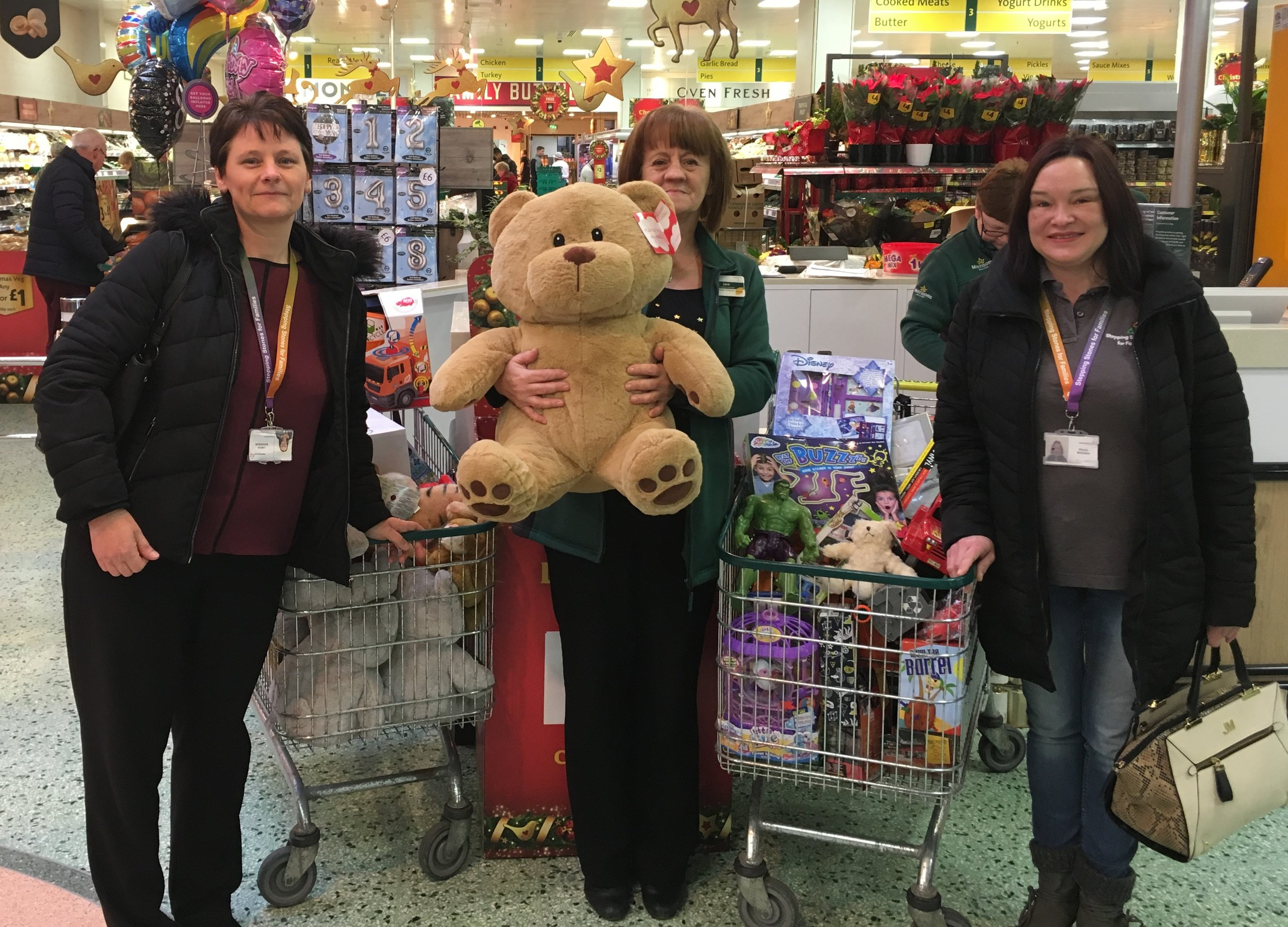 Staff from our Family Wellbeing Service and Carrick Money Advice Service pick up the generous toy donations from staff and customers of Morrisons in Ayr....