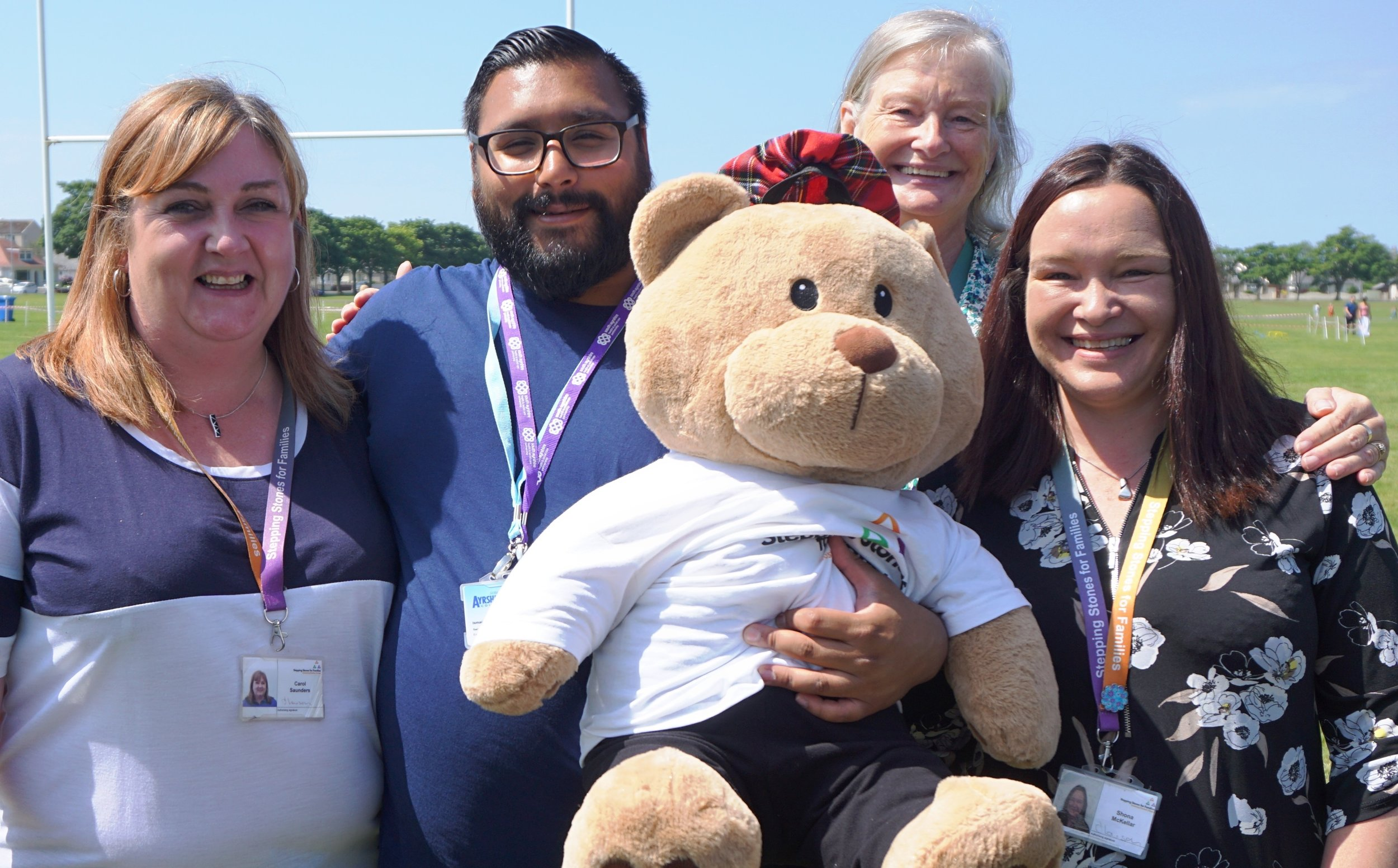 Stepping Stones for Families CMAS team, introducing Hamish the bear our 30th Anniversary mascot to Isaac, South Ayrshire Council.