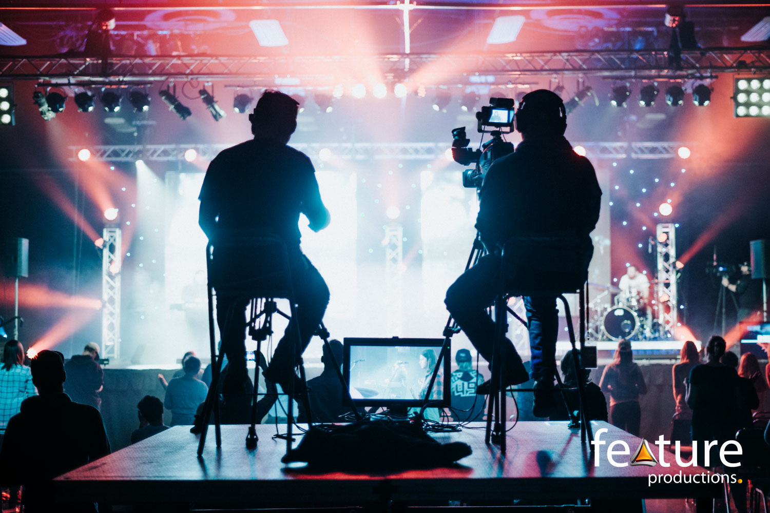camera-riser-concert-stage-lighting-feature-productions-logo.jpg