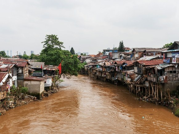 The Sea is Consuming Jakarta and its People aren't Insured - Jakarta is sinking and at the worst possible time…