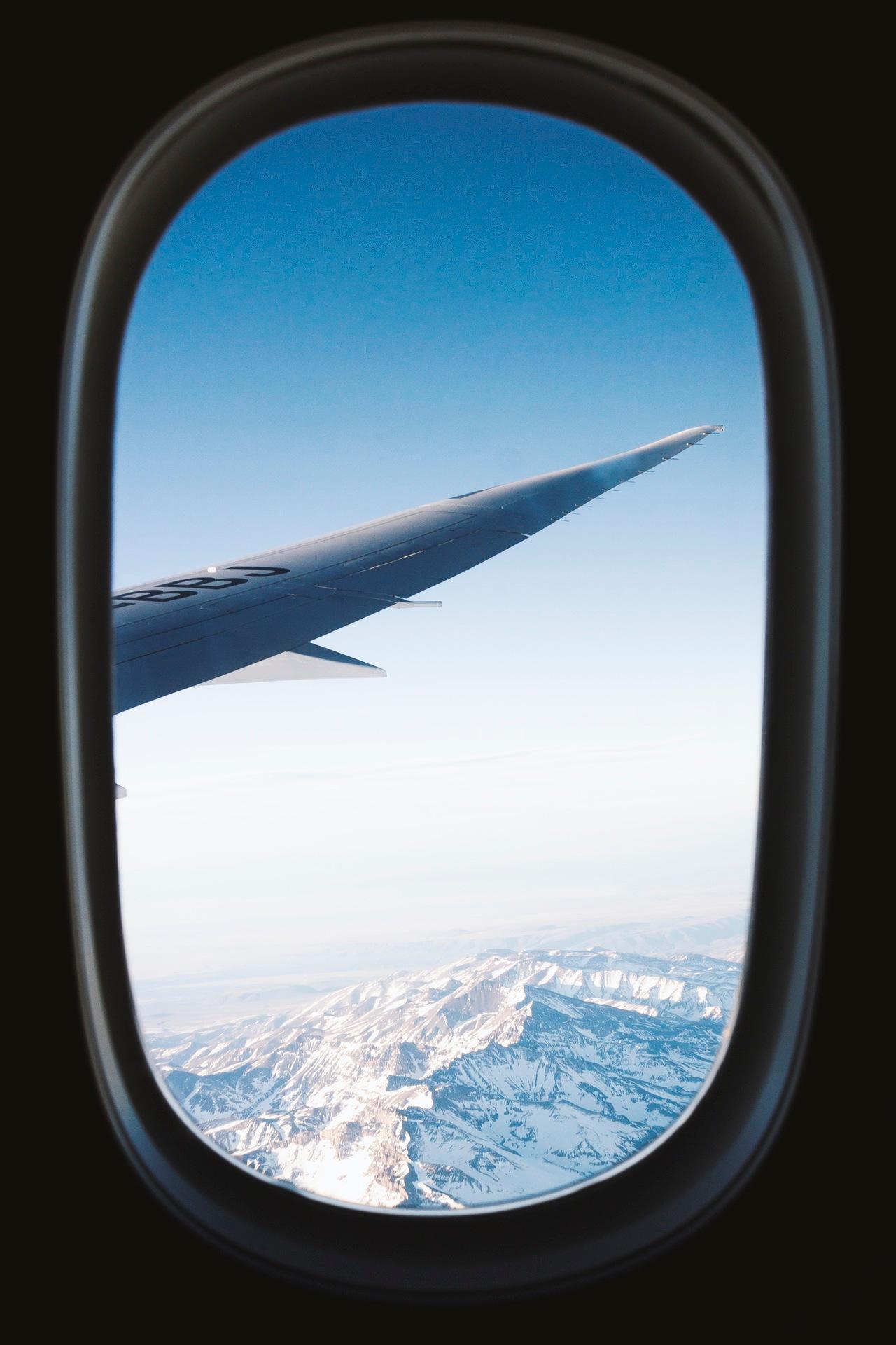screw_the_average_airplane_window_mountains