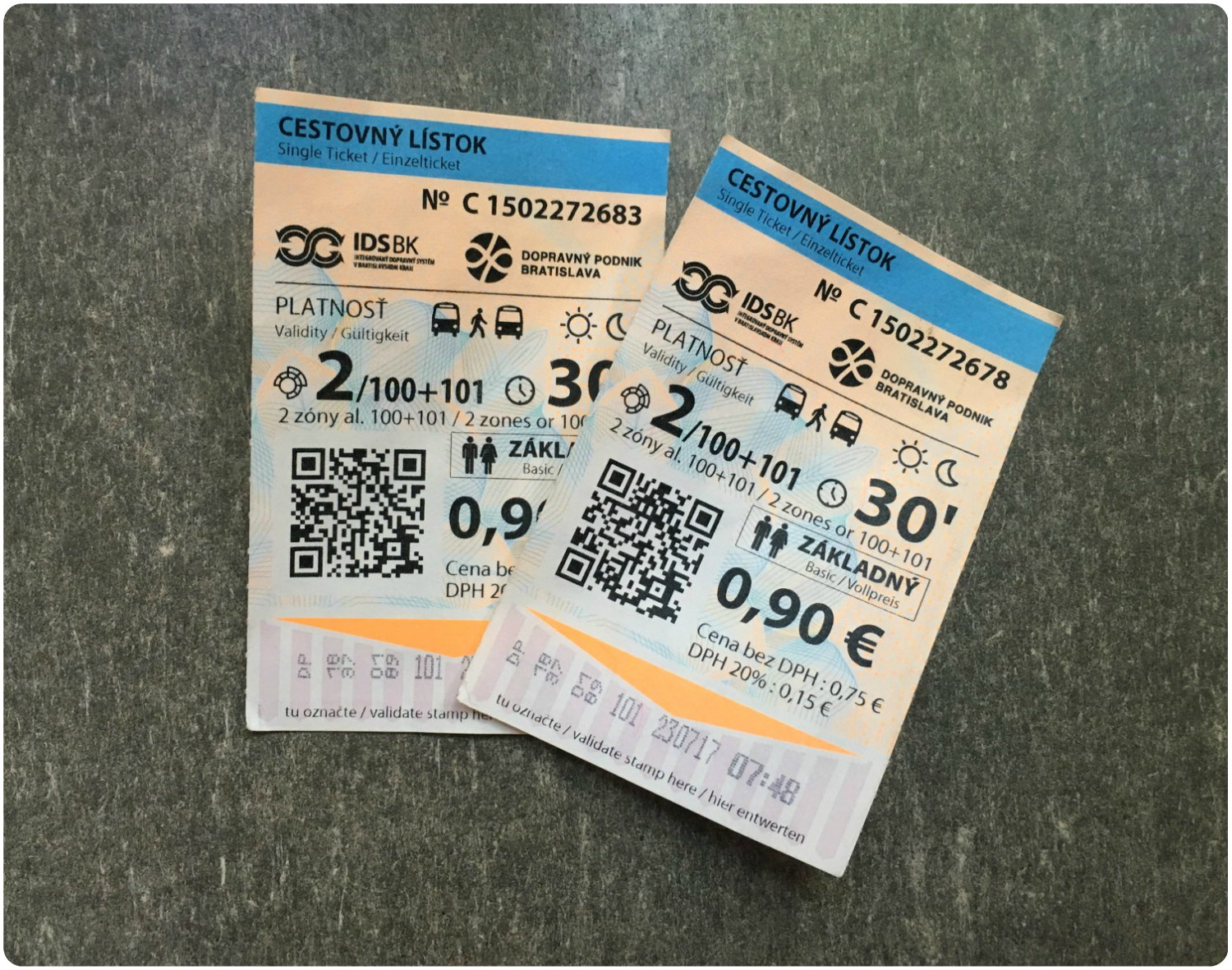 Our Bratislava Single Journey Tickets. Look closely and you can see the validation stamp beneath the orange arrow, which indicates the direction to insert the ticket into the validating machine.