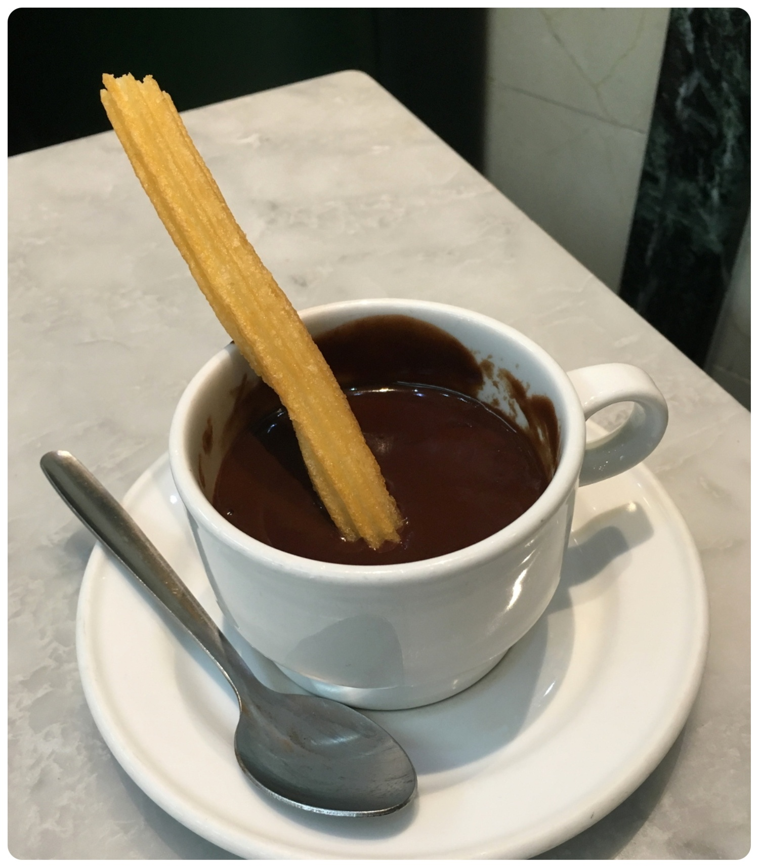 A traditional Spanish churro smothered in drinking chocolate. Just don't confuse the Spanish churro with a Mexican churro, they're quite different!
