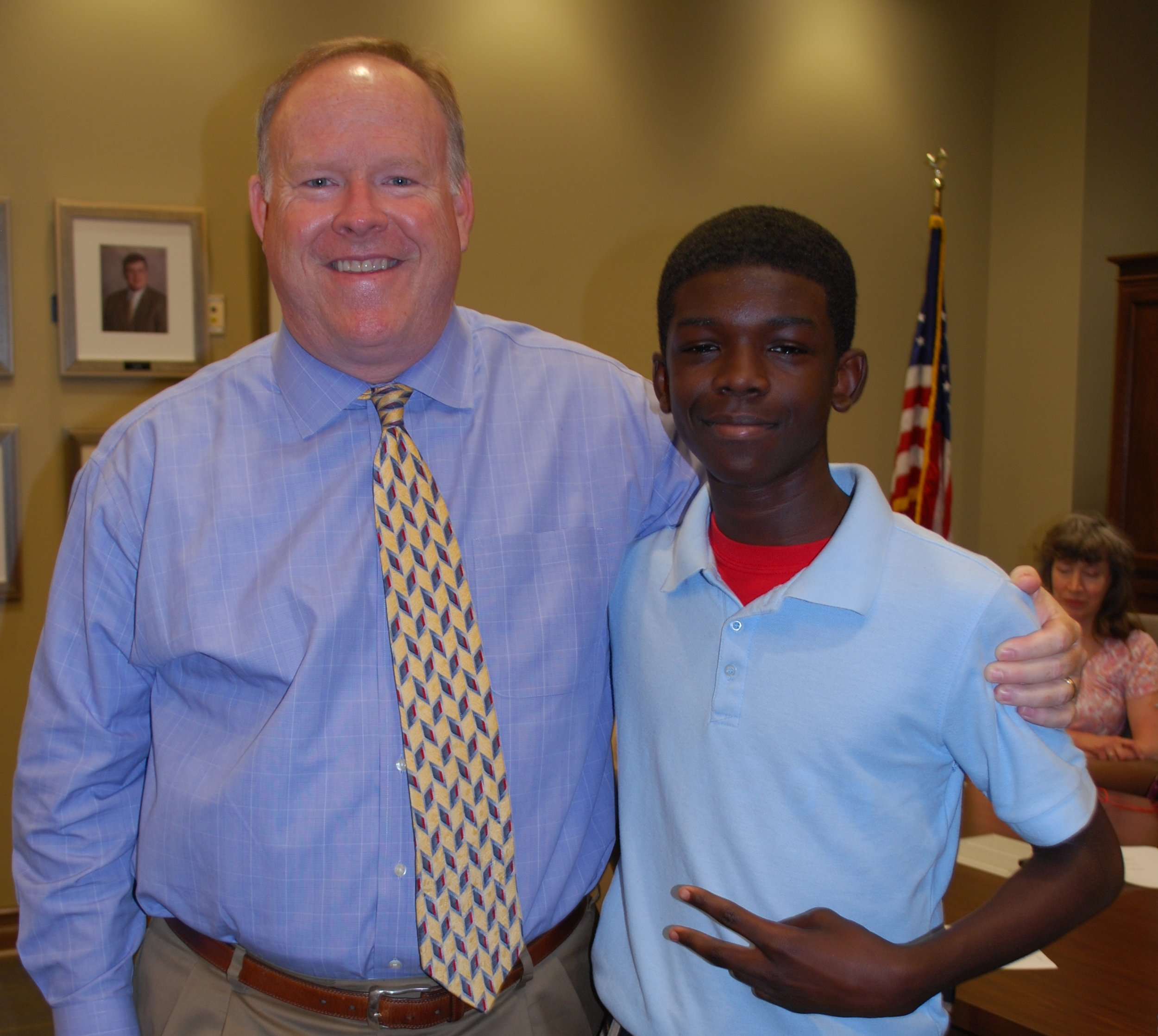 """Big Brother Jeff and Little Brother Ervin began their friendship one year ago through the BBBS Workplace Mentoring Program. They immediately connected very well, and after one month matched, Jeff told BBBS staff that they had found the """"perfect match"""" for him!  You may see Jeff teaching Ervin how to start a business, how to run new football plays, and how to overcome some of life's challenges.  As the City Manager of Vestavia Hills, Alabama, Jeff has encouraged many other Big Brothers and Big Sisters to participate in the program, and he is eager to continue with the Workplace Mentoring Program at City Hall for many years to come.  As Ervin gets to visit Jeff at Vestavia Hills City Hall, Ervin says that he always loves """"going to Jeff's office and getting to sit in the big boss chair!"""" Jeff has enjoyed watching Ervin's football games and supporting him in all that he does. Jeff and Ervin are excited to continue to build their relationship for many years to come!"""