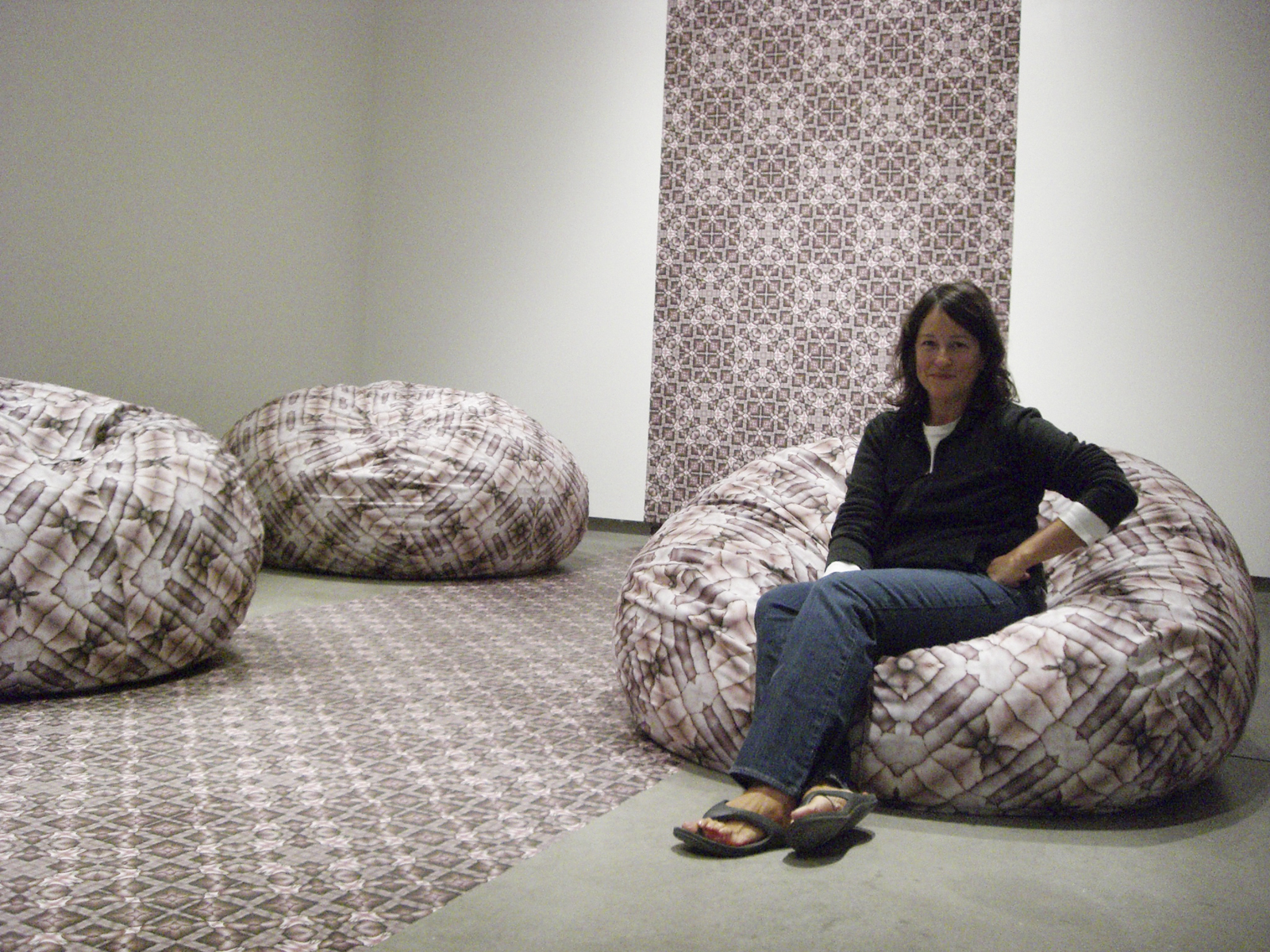 Jenny seated in her We Are Family Installation, ICA @ MECA