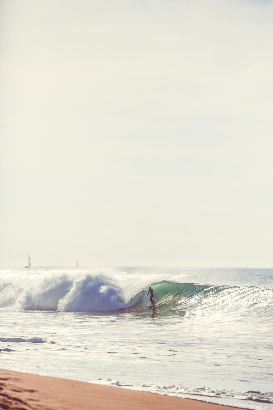 man surfing on the seashore.jpg