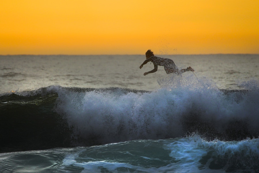 Man jumping off a wave.jpg