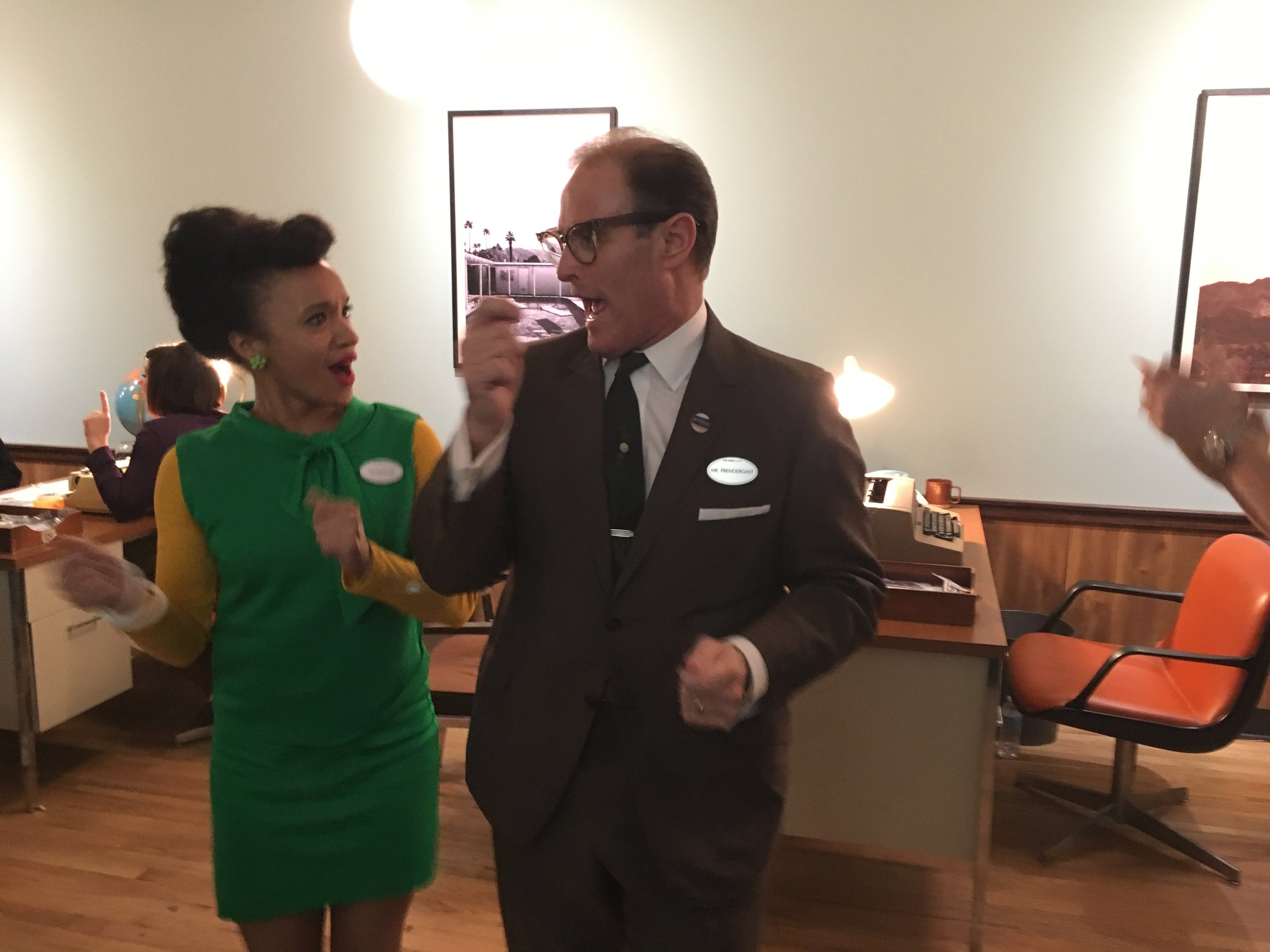 The quirky owner and a travel agent breaking into some 1960s dancing