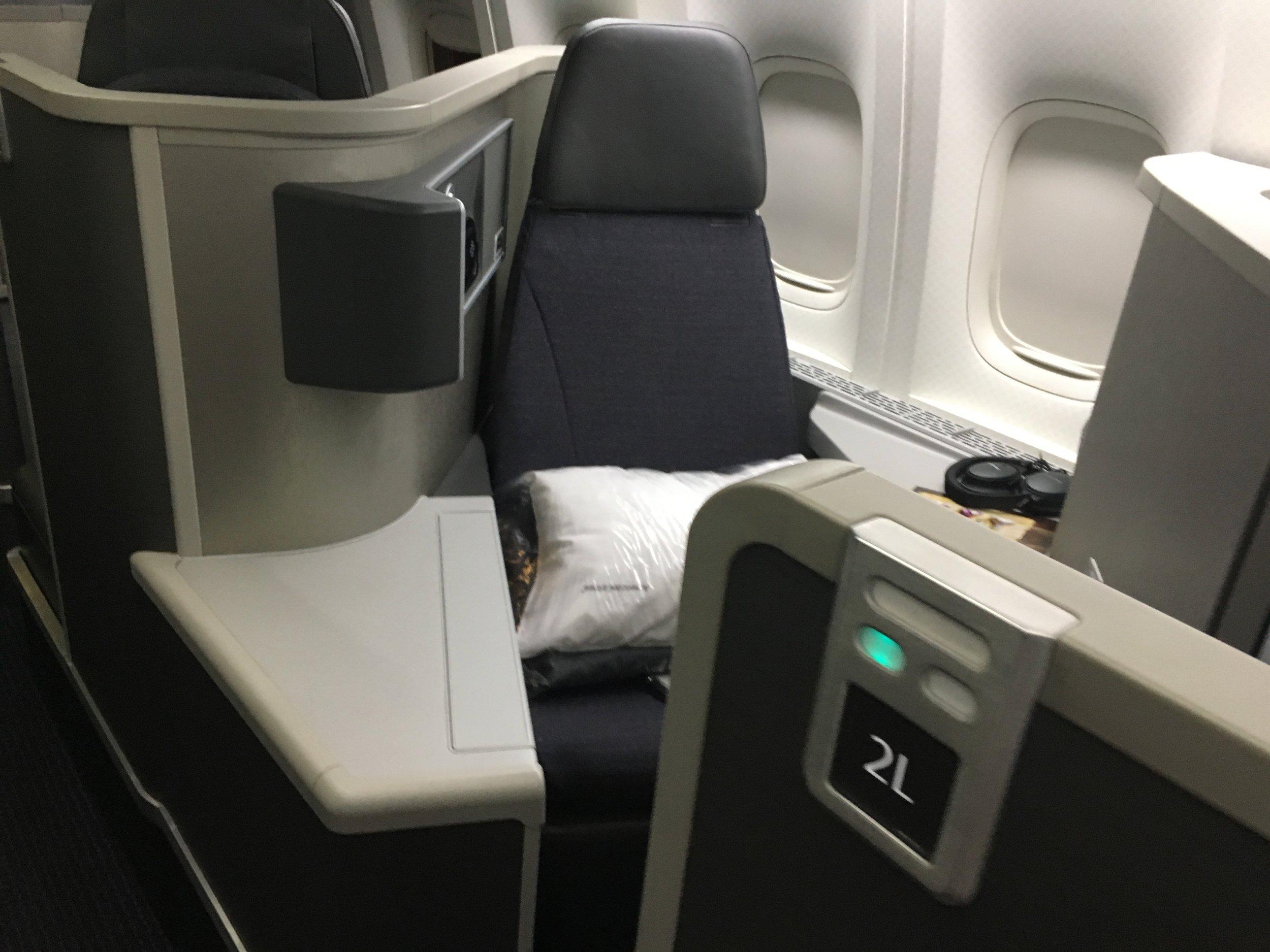 Rear-facing seat on American's 777-200