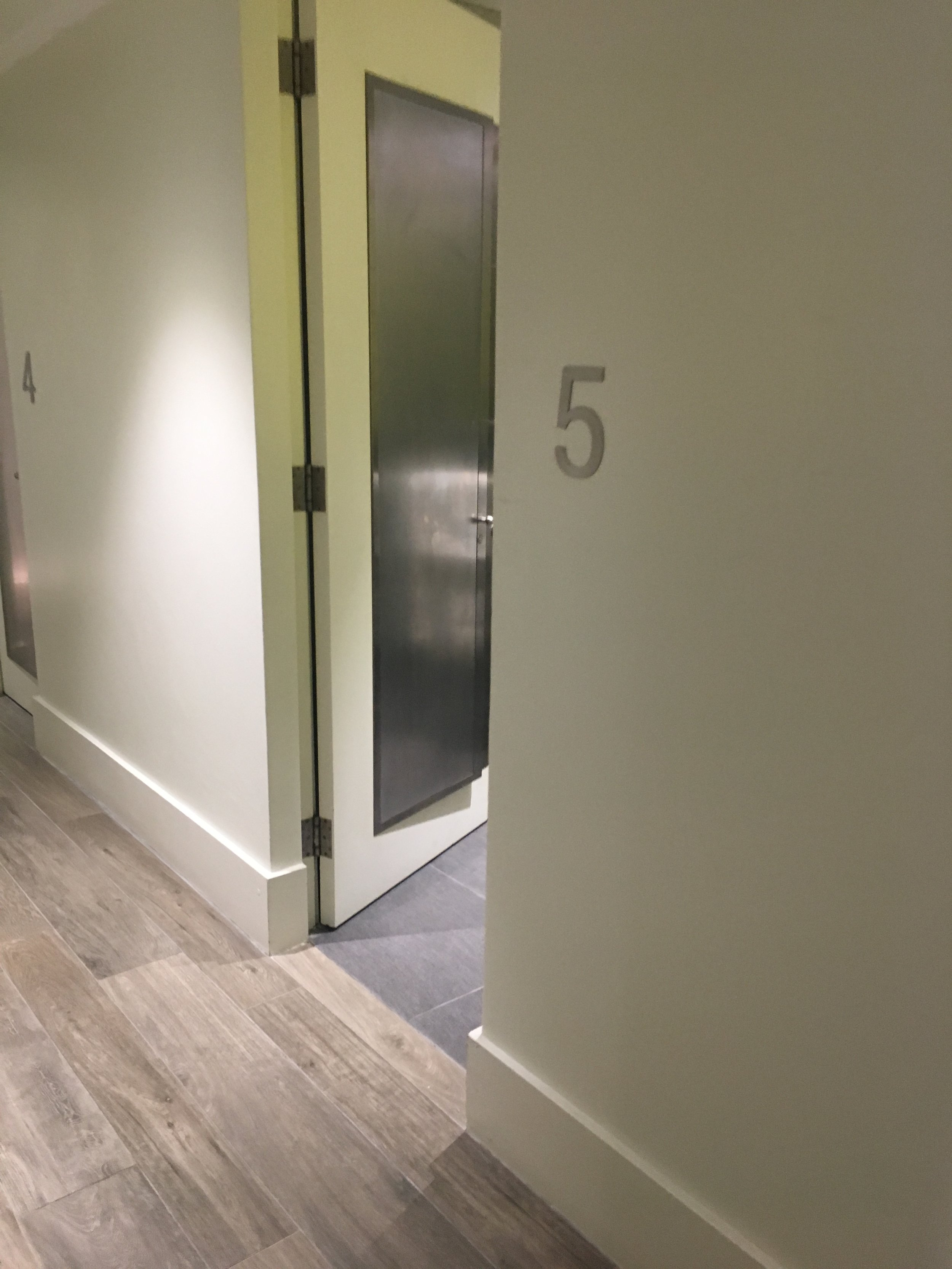A long hallway features 23 fresh shower rooms