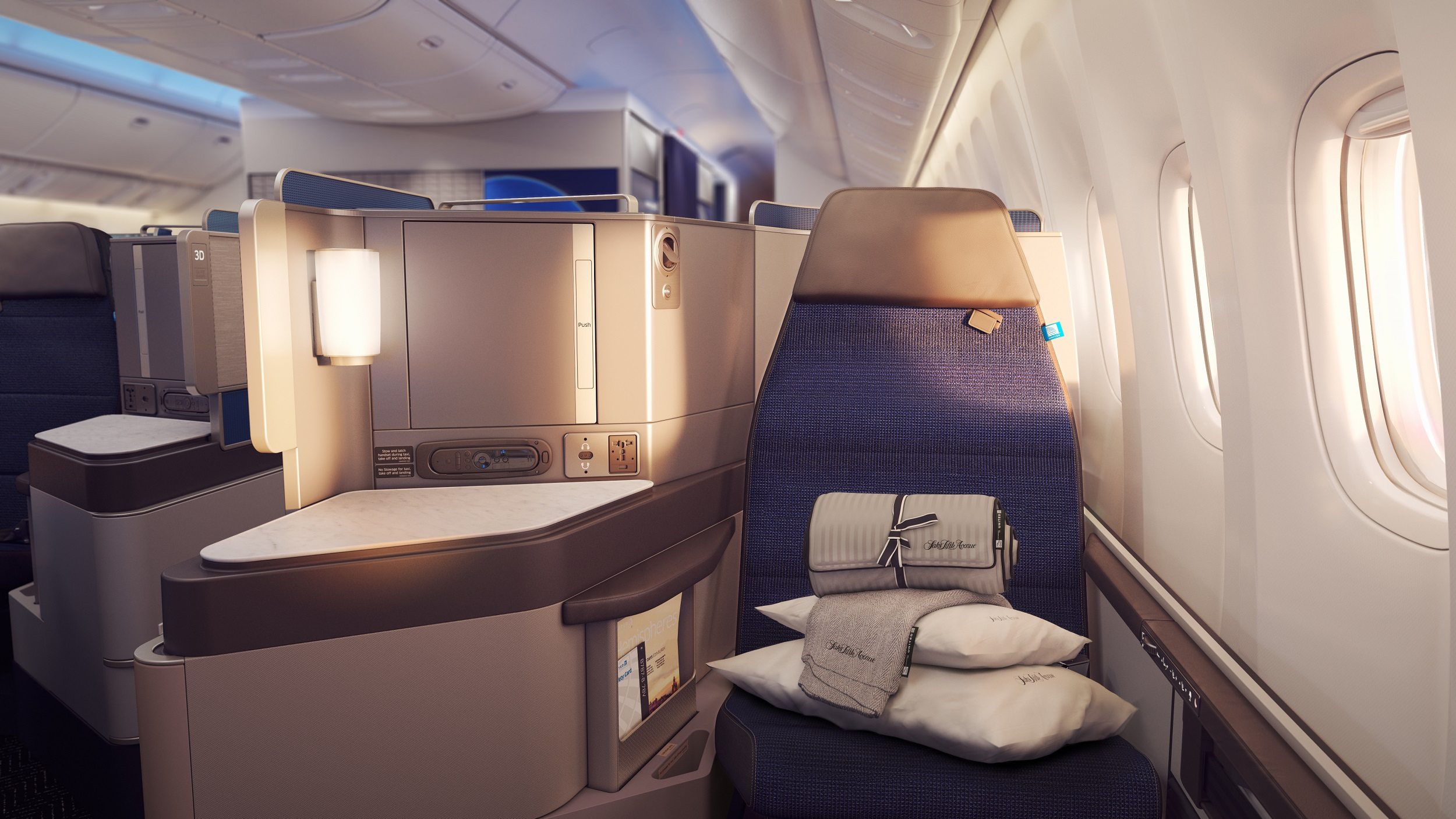 "United ""Polaris"" business class seat. This product won't be available for a while, but the older business class seat is still installed on most international planes. (via United)"
