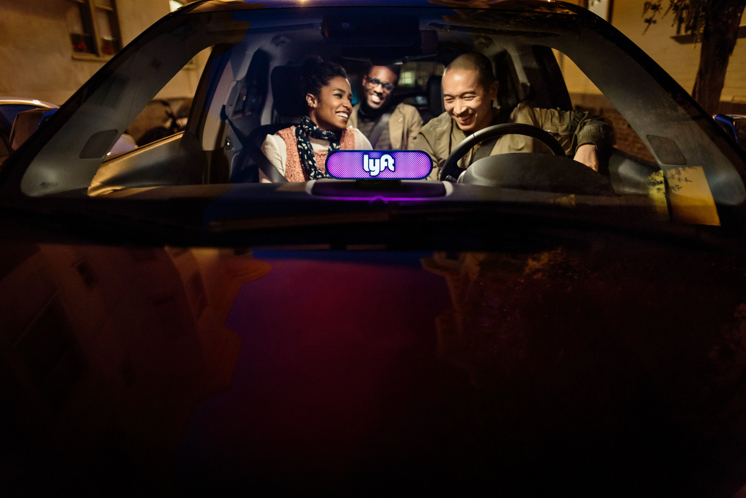 Suspiciously happy Lyft-ers. Maybe they're really psyched for those miles? (Photo: Lyft)