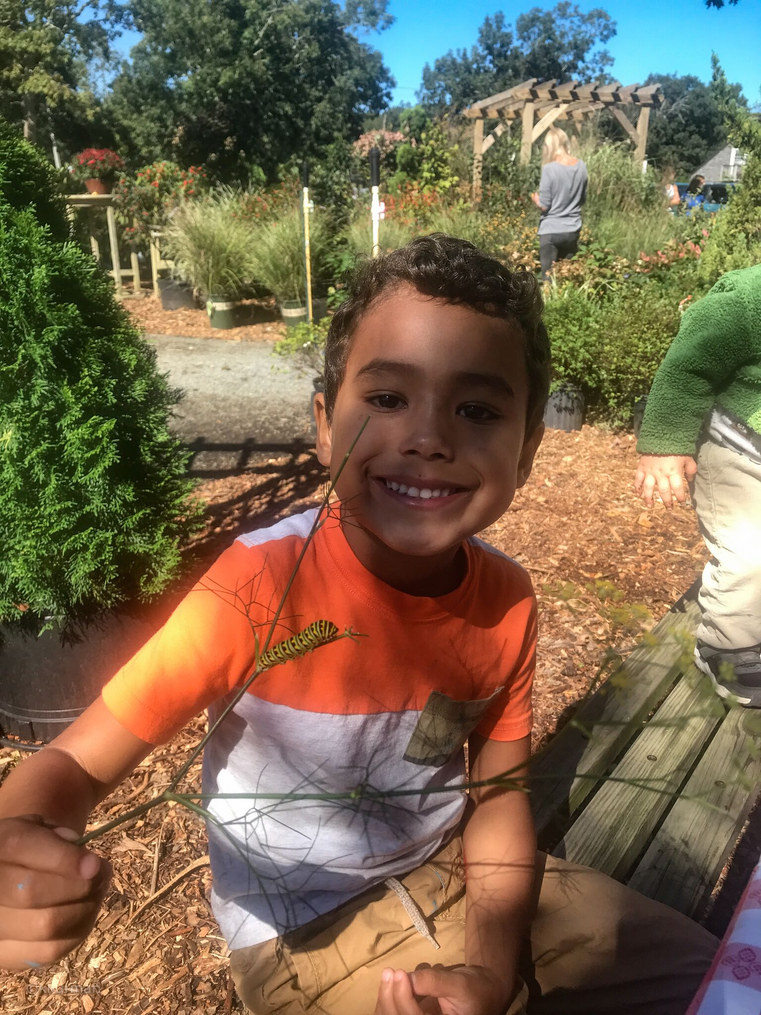 One of our guests, Bryan Rosa enjoying a visit with a Monarch caterpillar