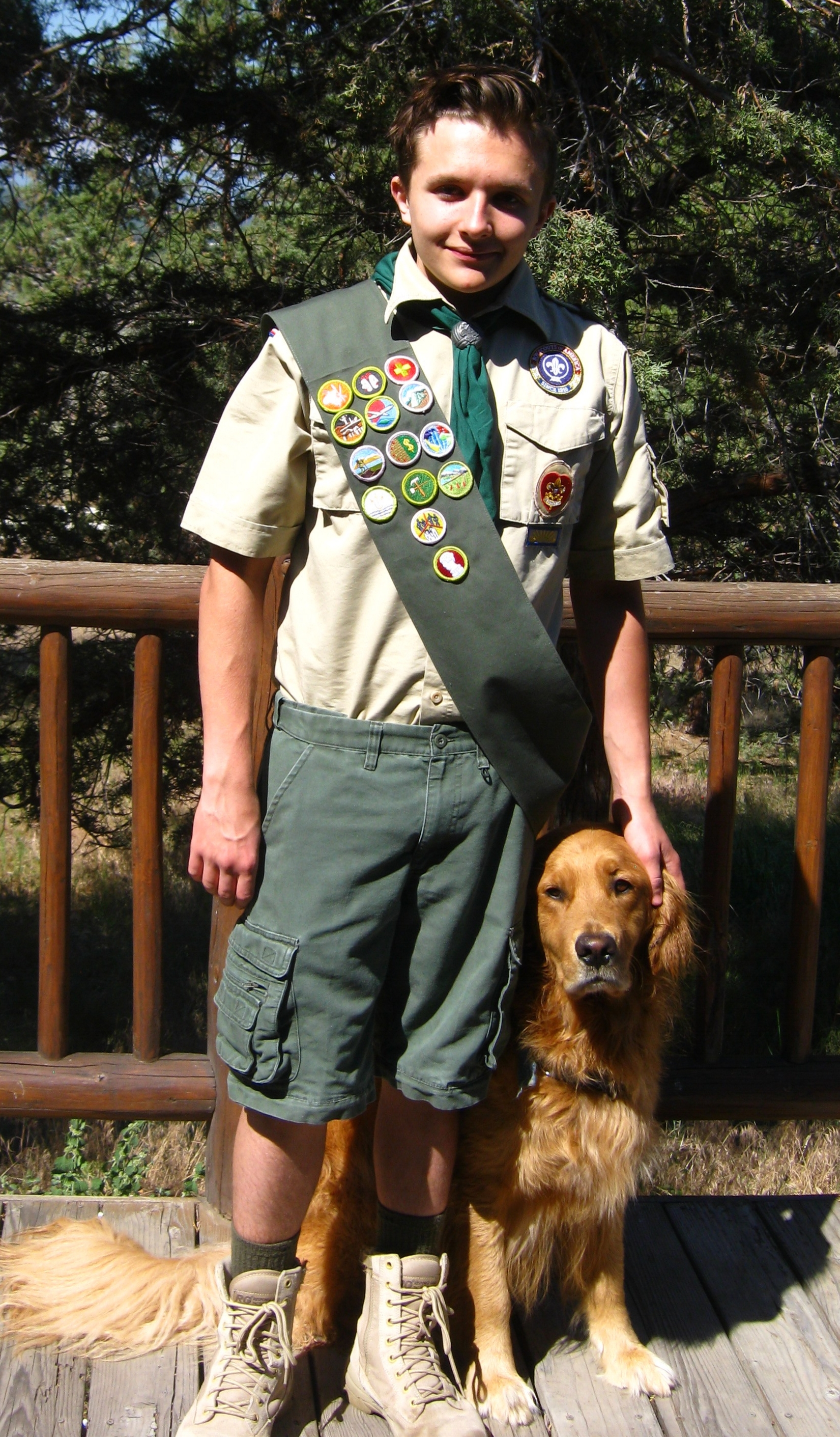 "Here is Wyatt in his Boy Scout uniform with his dog ""Bjorn""."